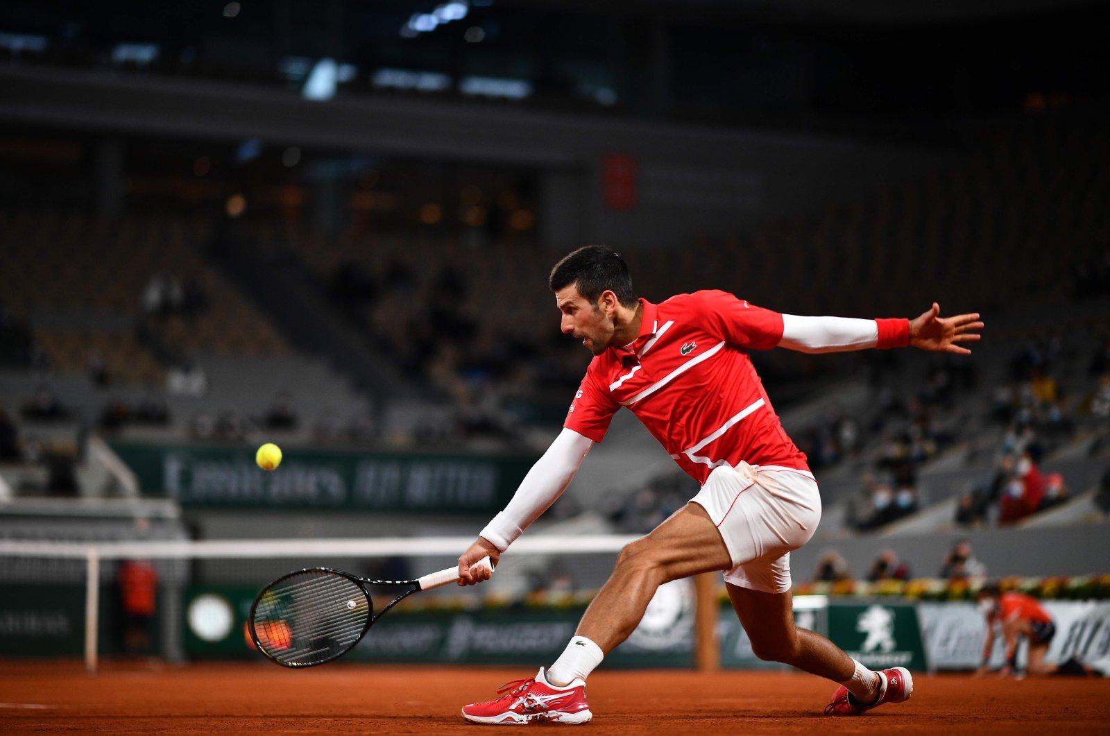 Serbia's Novak Djokovic returns the ball to Russia's Karen Khachanov during their men's singles fourth-round tennis match on Day 9 of the Roland Garros 2020 French Open tennis tournament in Paris, France, Oct. 5, 2020. (AFP Photo)
