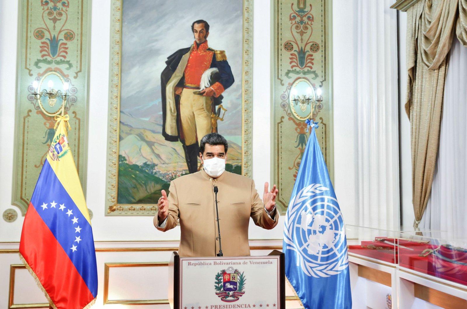 Venezuela's President Nicolas Maduro wears a mask as he gives a televised message from Miraflores Presidential Palace in Caracas, Venezuela, Sept. 21, 2020. (Venezuelan Presidency handout/AFP)