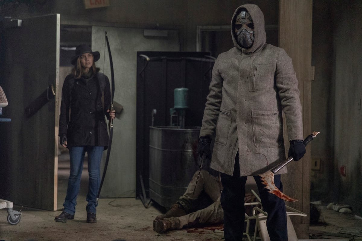 Maggie (L) and the masked warrior in a scene in 'The Walking Dead' season finale.