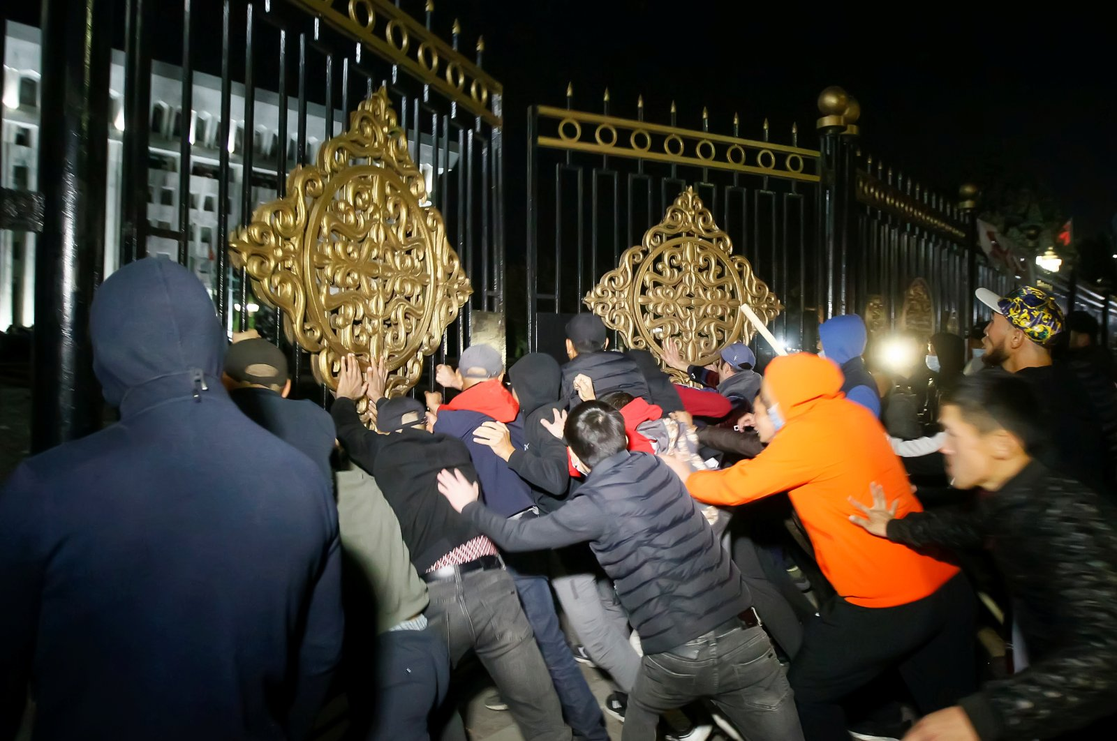 Protesters try to break into the government headquarters during a rally against the result of a parliamentary election in Bishkek, Kyrgyzstan, Oct. 5, 2020. (Reuters Photo)