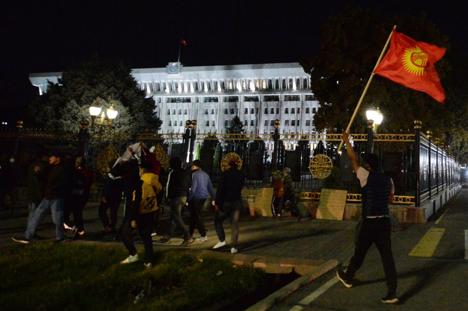 Protesters walk towards the government headquarters during a rally against the results of a parliamentary vote in Bishkek, Kyrgyzstan, Oct. 5, 2020. (AFP Photo)