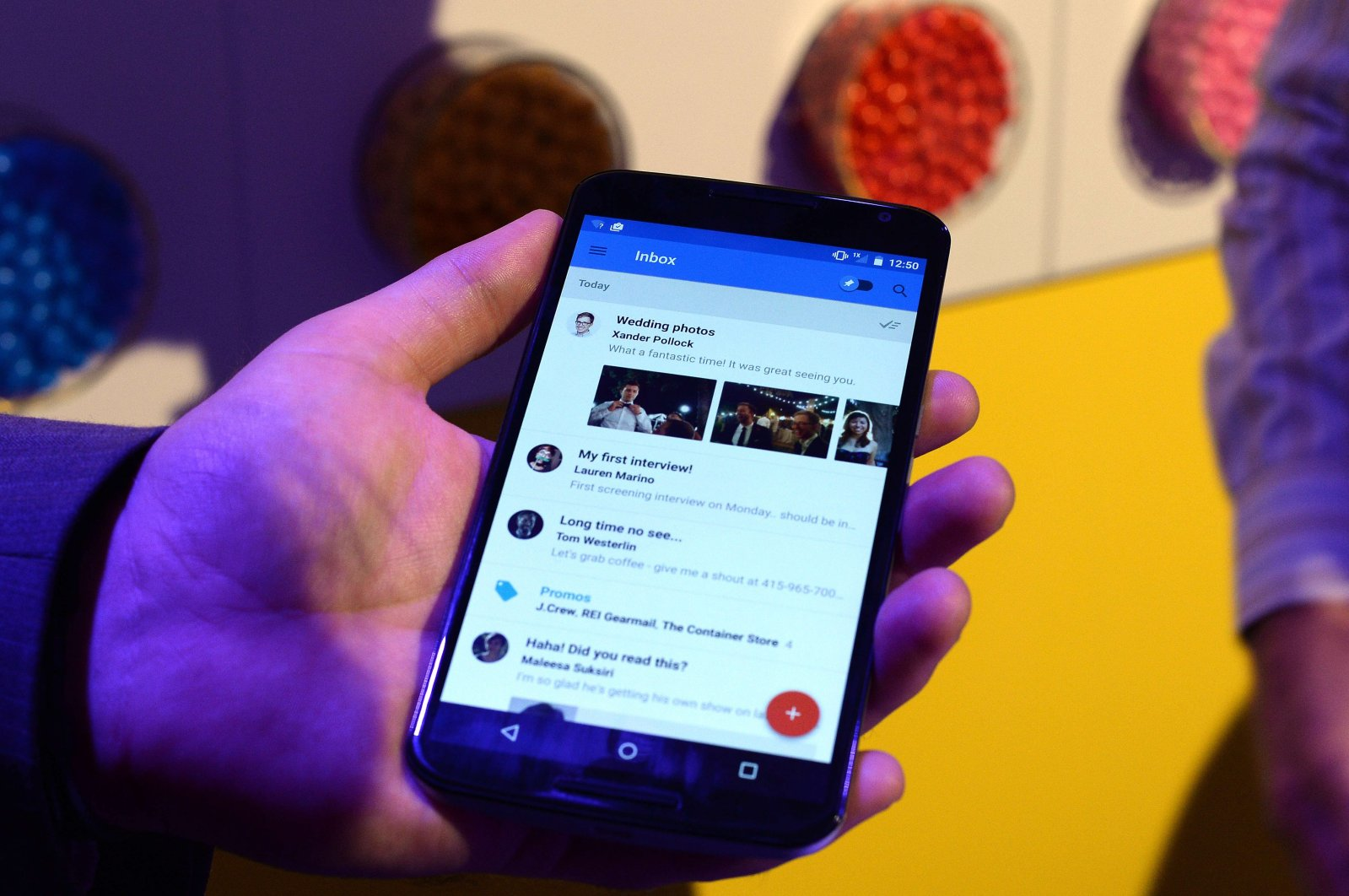 """This October 29, 2014 file photo shows Google's lead designer for """"Inbox by Gmail"""" Jason Cornwell as he shows the app's functionalities on a nexus 6 android phone during a media preview in New York. (AFP Photo)"""