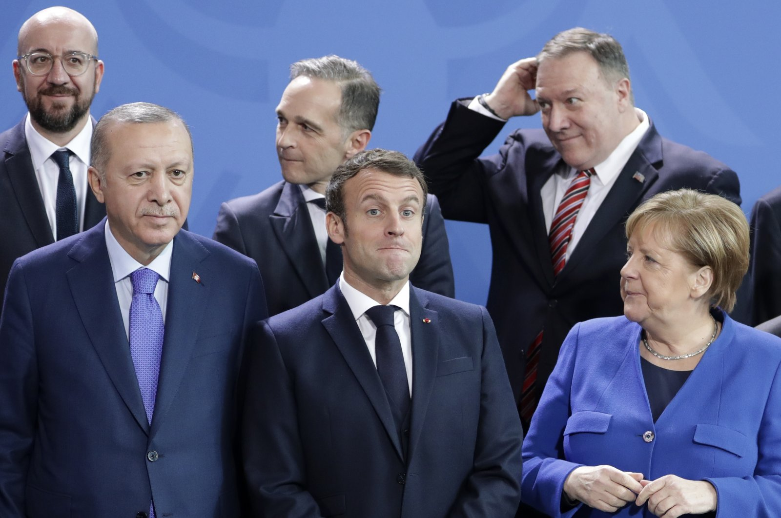 In this Sunday, Jan. 19, 2020 file photo, German Chancellor Angela Merkel, front right, speaks with French President Emmanuel Macron, front center, and Turkish President Recep Tayyip Erdoğan during a group photo at a conference on Libya at the chancellery in Berlin, Germany. (AP Photo)