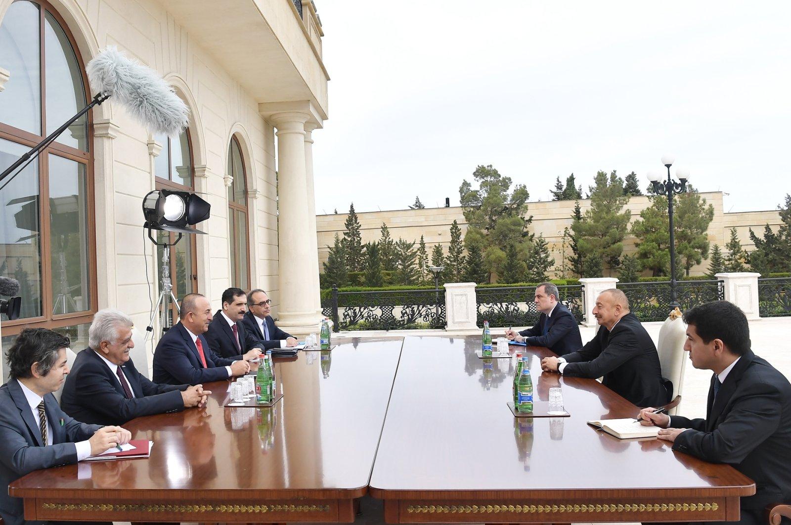 Foreign Minister Mevlüt Çavuşoğlu attends a meeting with Azerbaijani President Ilham Aliyev in Baku, Azerbaijan, Oct. 6, 2020. (AA Photo)