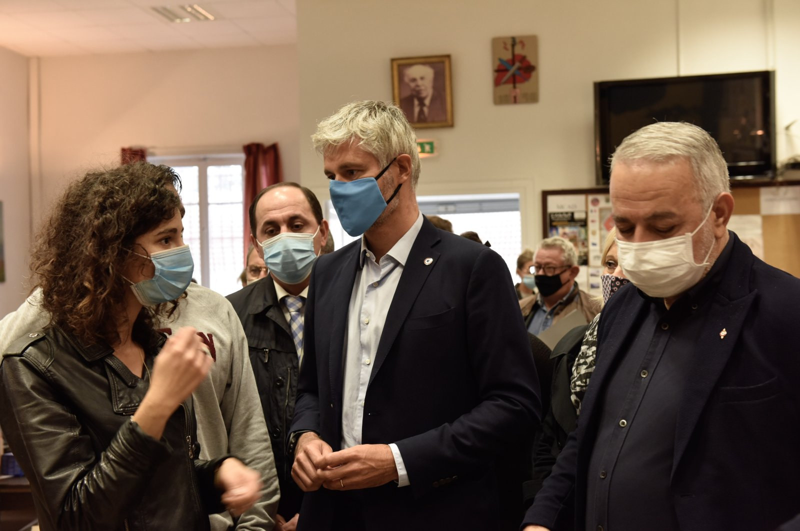 French politician Laurent Wauquiez (C) talks with other attendees of an event in the Auvergne-Rhone-Alpes region of France, in a photo shared Oct. 6, 2020. (Photo from Twitter @laurentwauquiez)