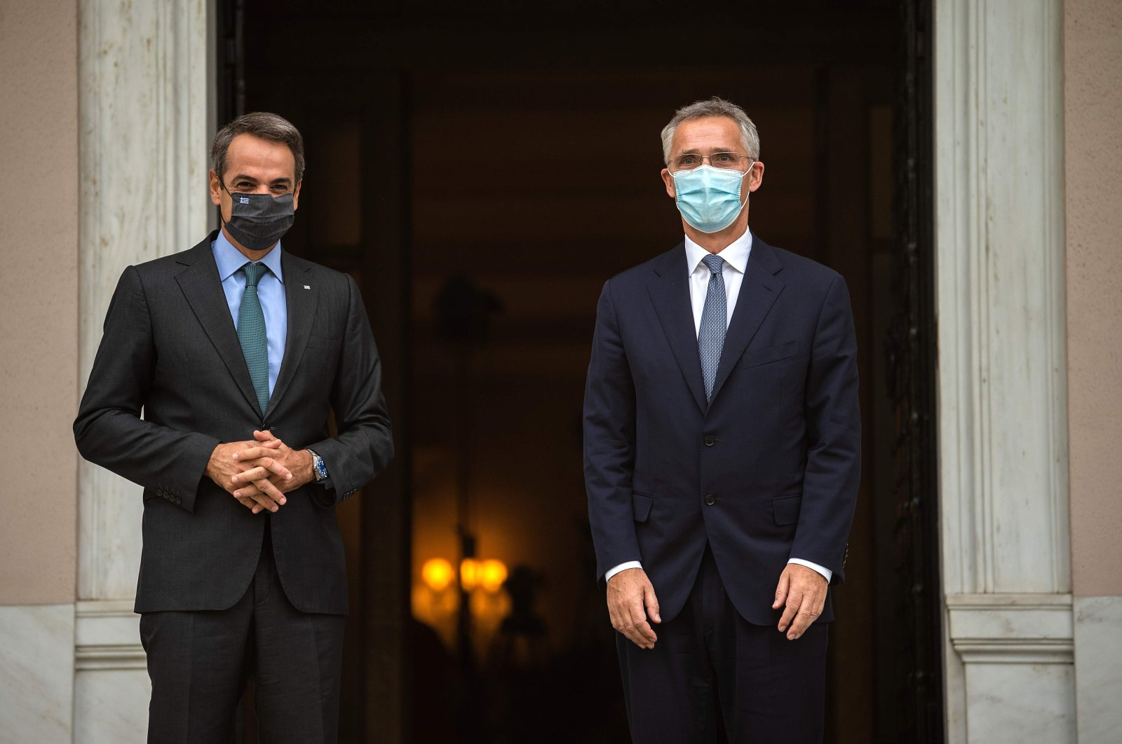Greek Prime Minister Kyriakos Mitsotakis (L) welcomes NATO Secretary-General Jens Stoltenberg (R) before their meeting at the Maximos Mansion in Athens, Greece, Oct. 6, 2020. (AFP Photo)