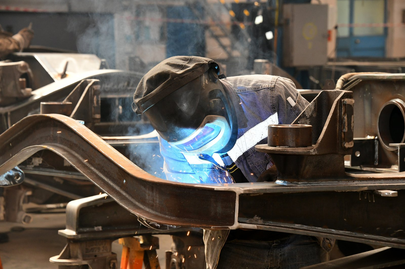 A worker welds in a factory manufacturing freight wagons in central Sivas province, Turkey, in this undated photo. (AA Photo)