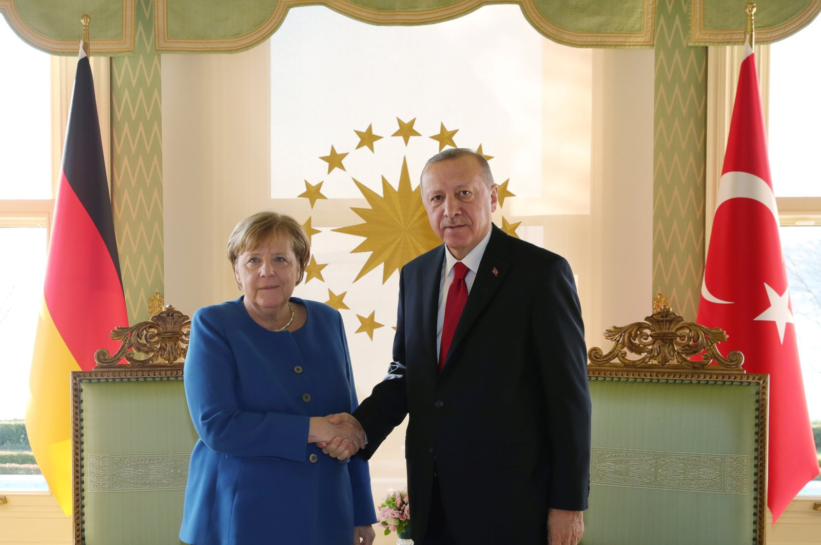 President Tayyip Erdoğan shakes hands with German Chancellor Angela Merkel during their meeting in Istanbul, Turkey, Jan. 24, 2020. (Presidential Press Office/Handout via Reuters)