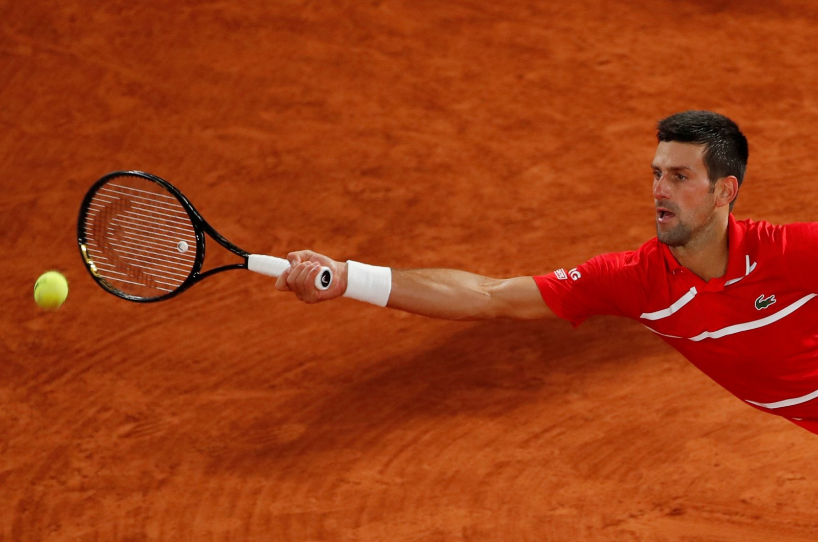 Novak Djokovic in action during a French Open match against Karen Khachanov, in Paris, France, Oct. 5, 2020. (Reuters Photo)