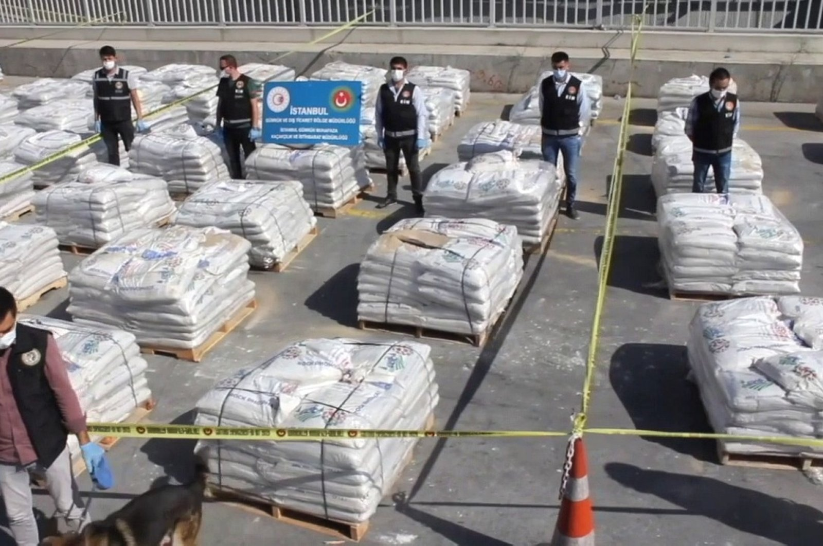 Police pose with sacks of fertilizers containing cocaine at the port, in Istanbul, Turkey, Oct. 6, 2020. (İHA Photo)