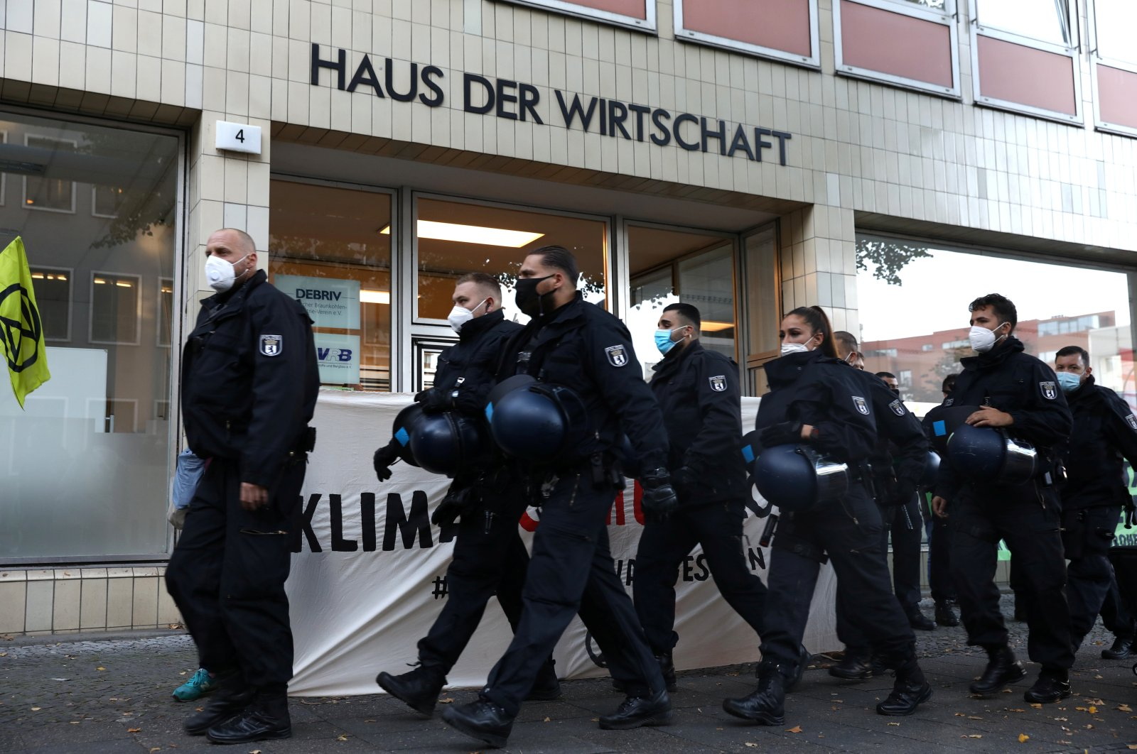 Police officers walk past Haus der Wirtschaft (House of Economy) as Extinction Rebellion activists take part in a protest in Berlin, Germany, Oct. 6, 2020. (Reuters Photo)