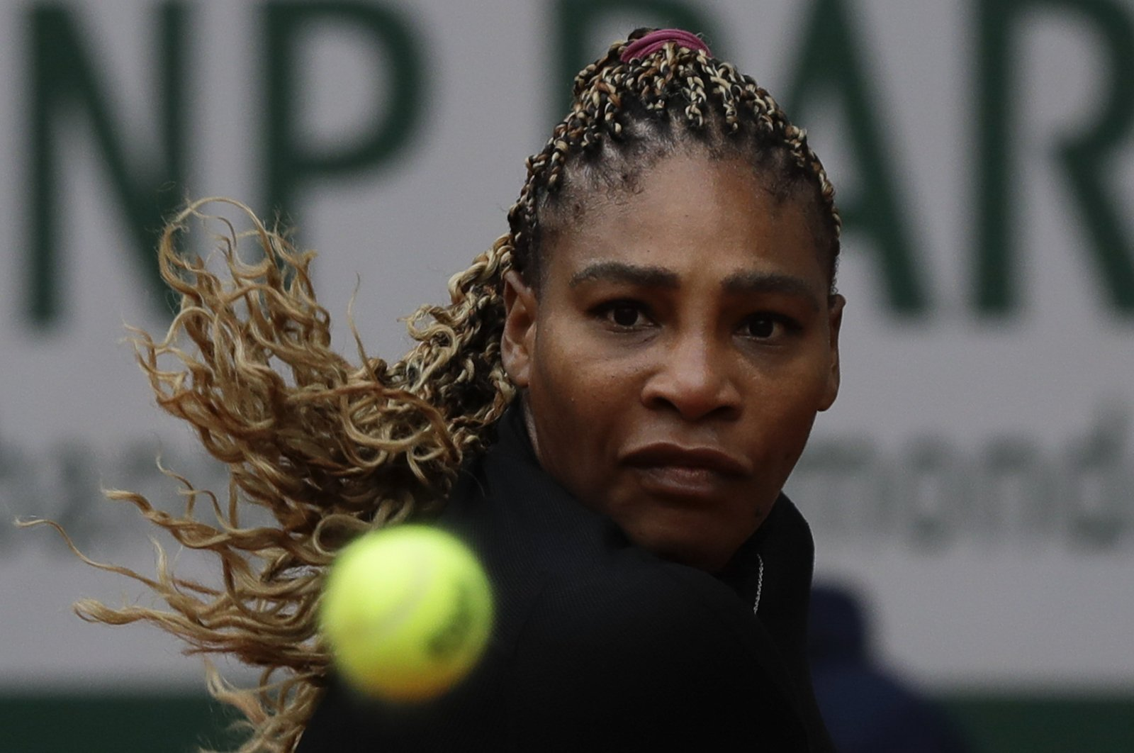 Serena Williams before she plays a shot against Kristie Ahn in the first round match of the French Open, in Paris, France, Sept. 28, 2020. (AP Photo)