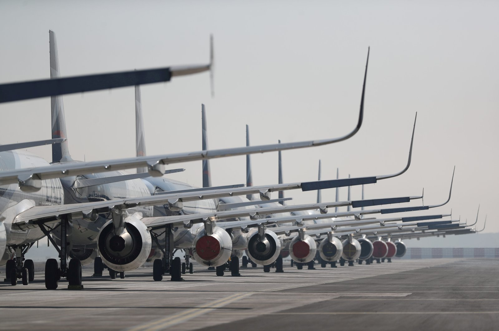 Passenger planes parked on a runway are seen during a general quarantine amid the spread of the coronavirus, at the Arturo Merino Benitez International Airport, in Santiago, Chile May 26, 2020. (Reuters Photo)
