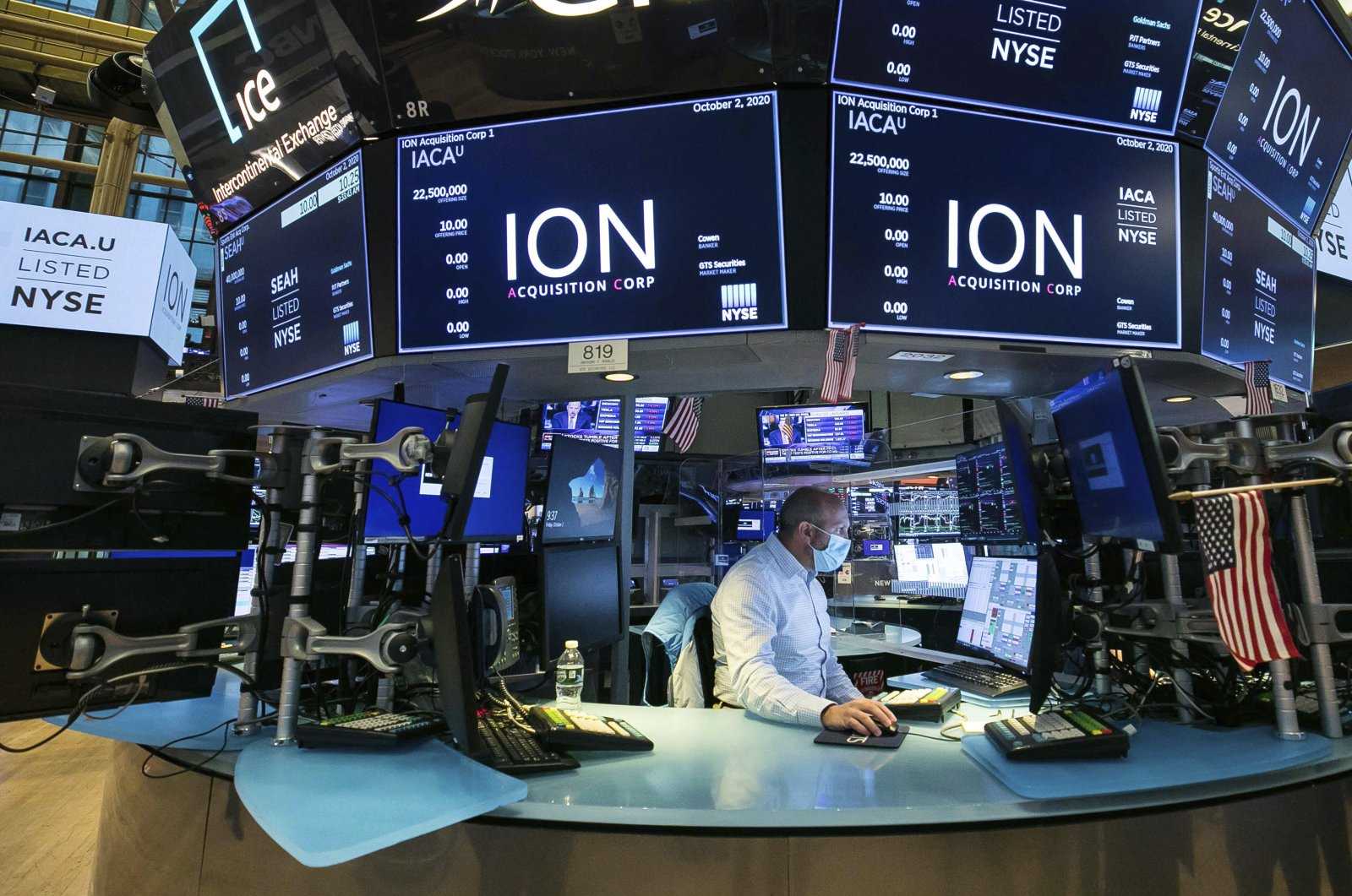In this photo provided by the New York Stock Exchange, a specialist works at his post on the trading floor during the listing of ION Acquisition Corp 1 Ltd., from Israel, Friday, Oct. 2, 2020. (Courtney Crow / New York Stock Exchange via AP)