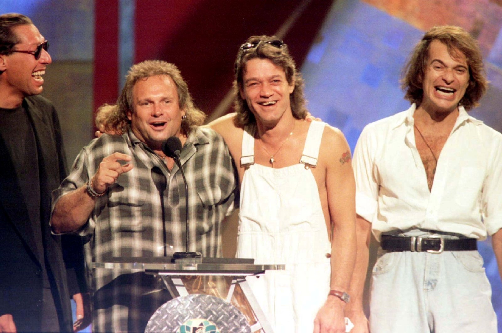 Members of the band Van Halen (L-R) Alex Van Halen, Michael Anthony, Eddie Van Halen are reunited with former lead singer David Lee Roth (R) on stage at the 1996 MTV Video Music Awards in New York on September 4. (Reuters Photo)