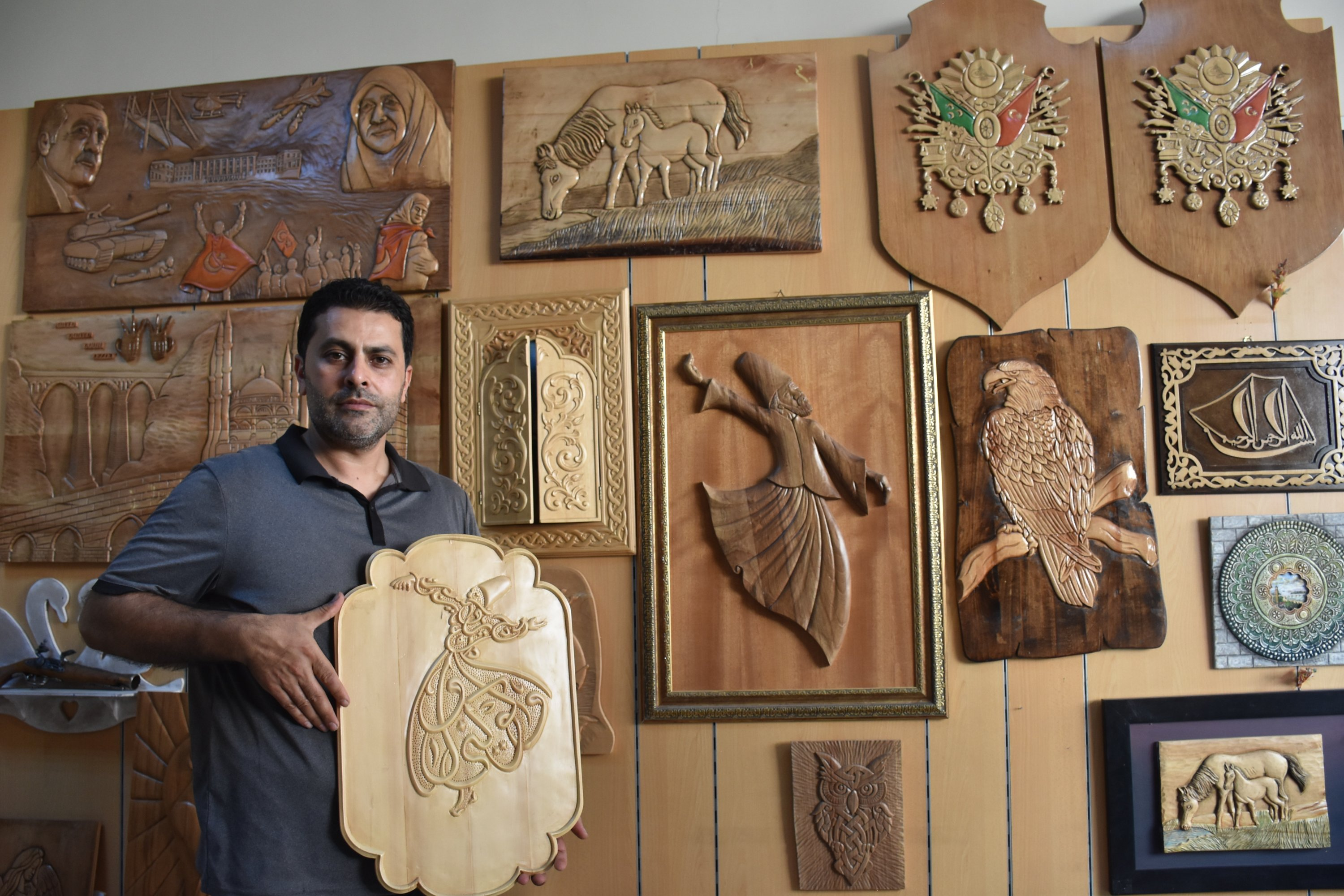 Serdar Tektaş poses with his works in his workshop, Adana, southern Turkey, Oct. 6, 2020. (AA Photo)