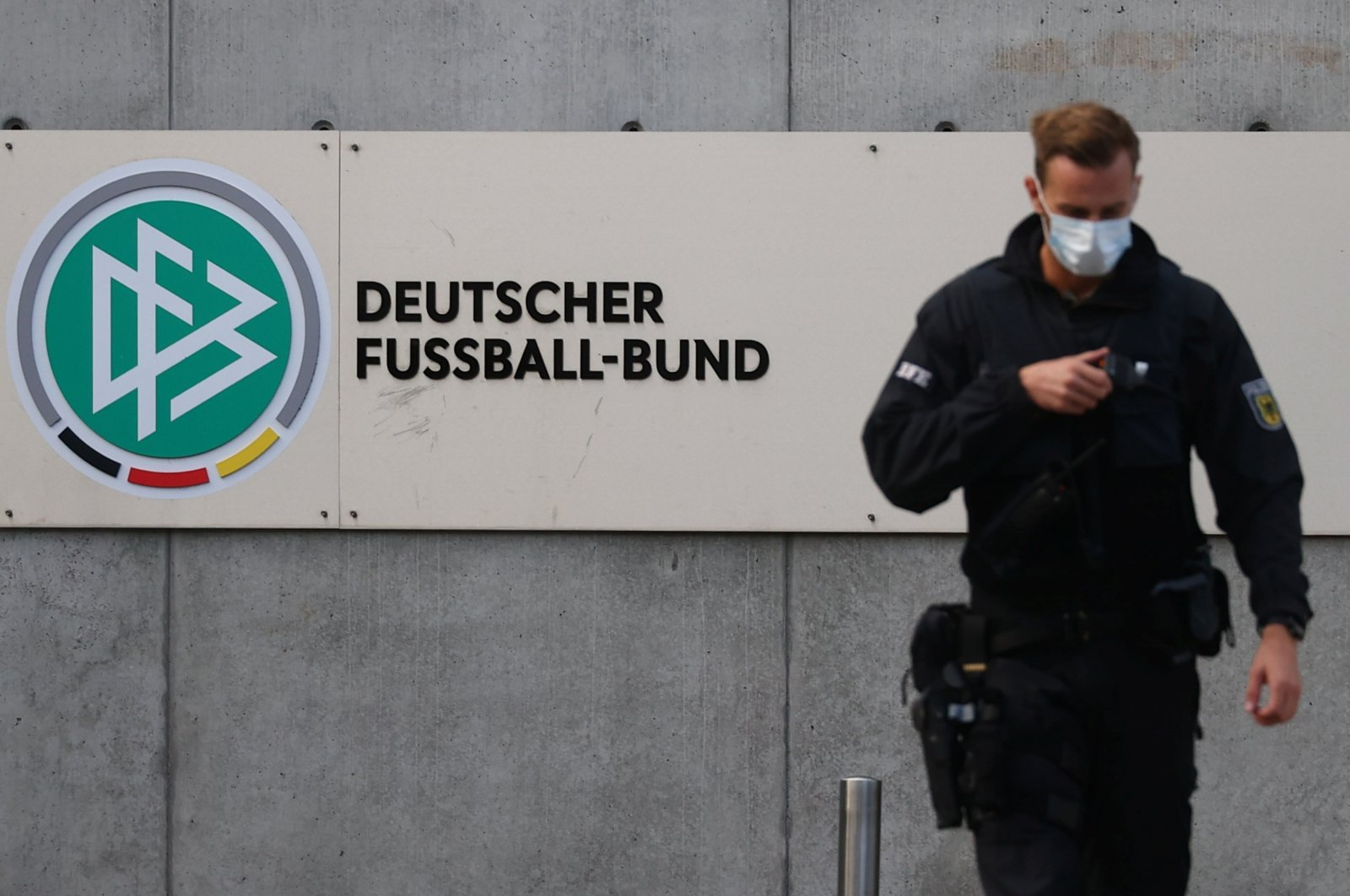 Police secure the area in front of the German Football Association (DFB) headquarters as German prosecutors and tax authorities search offices of the DFB, in Frankfurt, Germany, Oct. 7, 2020. (Reuters Photo)