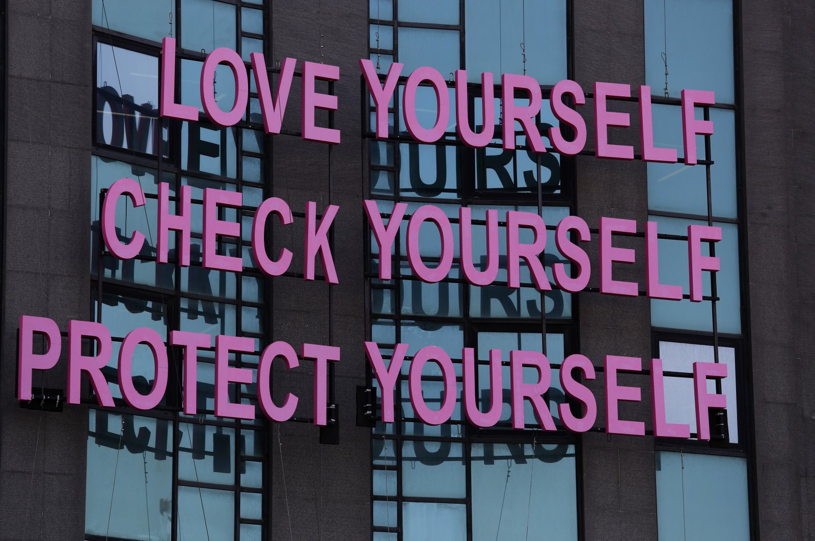 A message for breast cancer awareness decorates a building during a campaign for Breast Cancer Awareness Month, in Beirut, Lebanon, Oct. 11, 2018. (AP Photo)