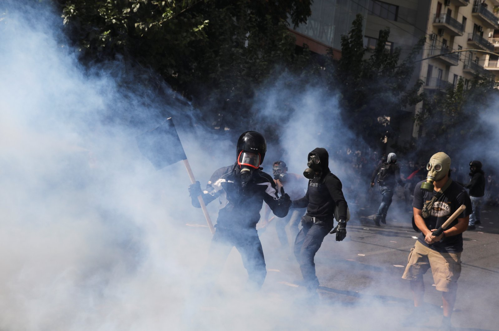 Protesters are seen among tear gas during clashes outside a court, Athens, Oct. 7, 2020. (REUTERS Photo)