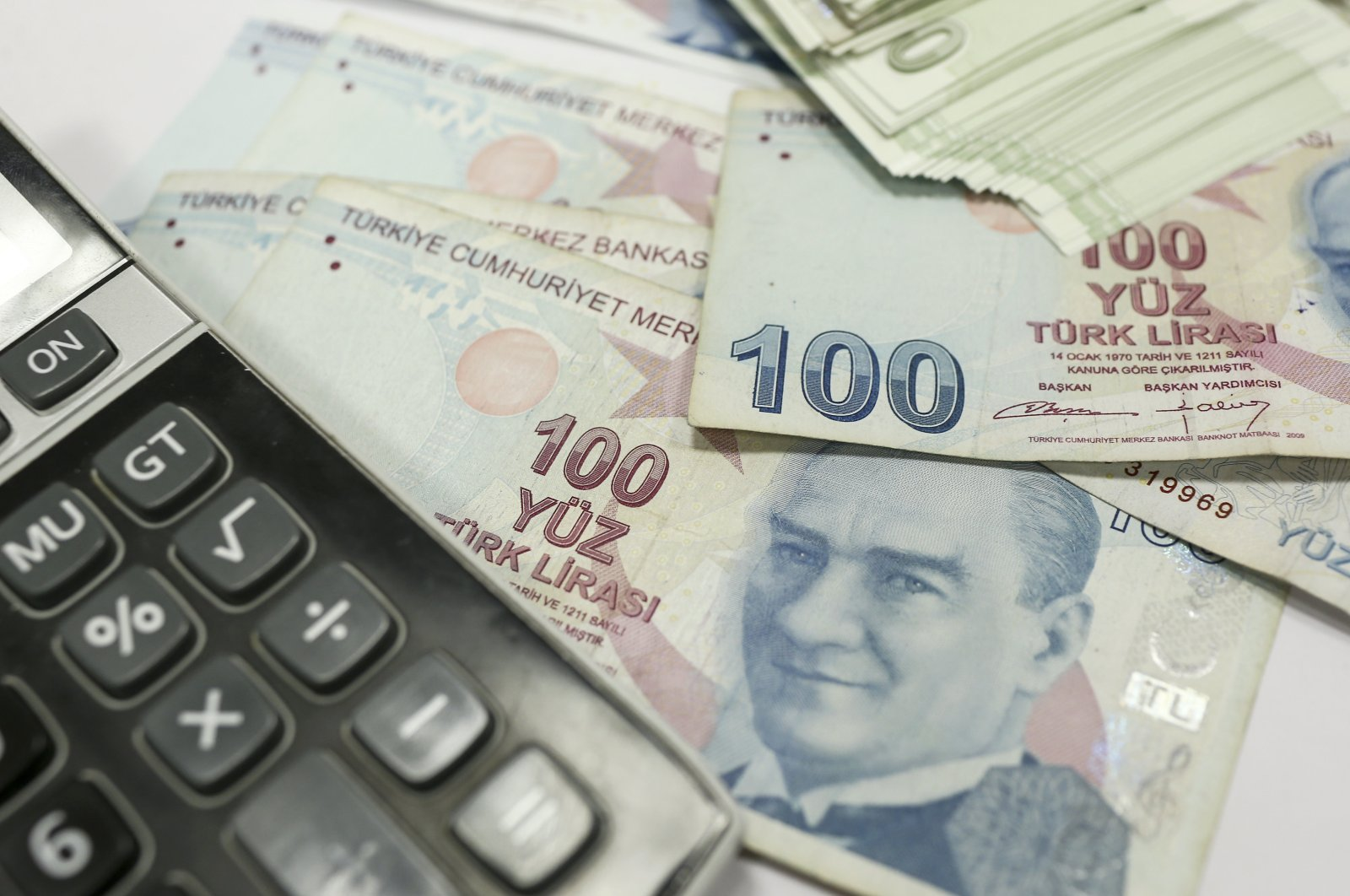This undated file photo shows Turkish lira banknotes next to a calculator. (AA Photo)