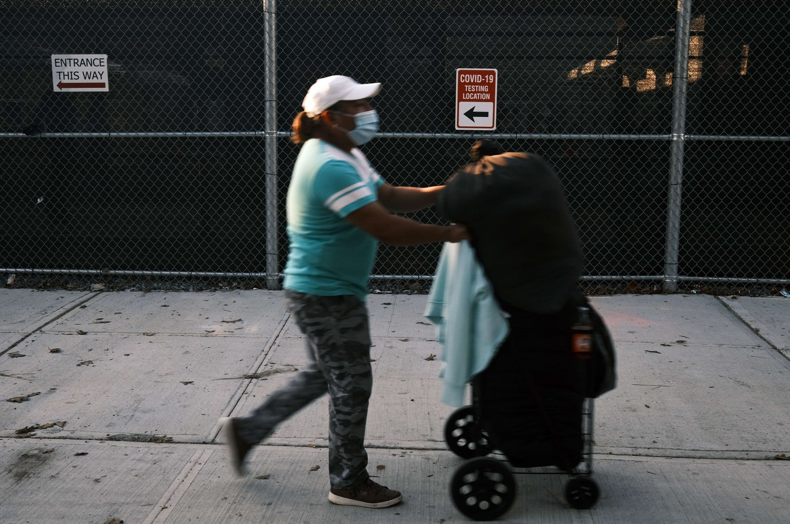 Residents walk by a COVID-19 testing site in the Brooklyn neighborhood of Borough Park on October 06, 2020 in New York City. (Getty Images/AFP Photo)