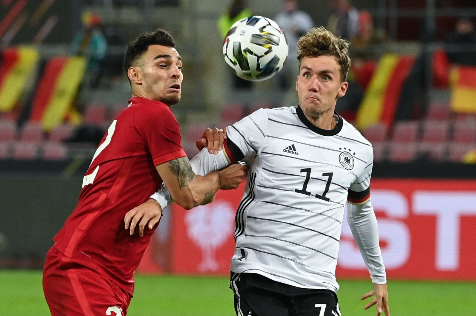 Germany's forward Luca Waldschmidt (R) vies for the ball with Turkey's midfielder Ahmed Kutucu (L) during the international friendly football match between Germany and Turkey in Cologne, western Germany, on October 7, 2020. (AFP Photo)