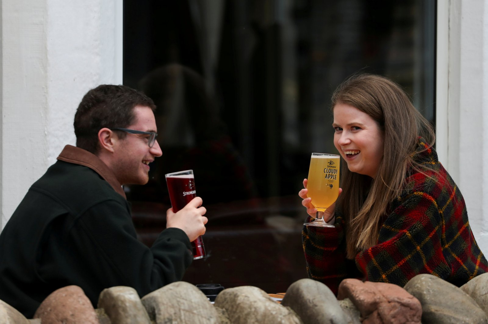 People drink outdoors in Pitlochry after Scottish First Minister Nicola Sturgeon announced new circuit breaker restrictions to counter the coronavirus pandemic, in Scotland, Oct. 7, 2020. (REUTERS Photo)