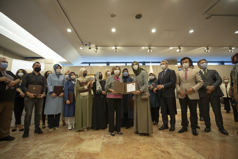 Deputy Minister of Culture and Tourism Özgül Özkan Yavuz (M) poses with award recipients at the National Library, the capital Ankara, Turkey, Oct. 7, 2020. (AA PHOTO)