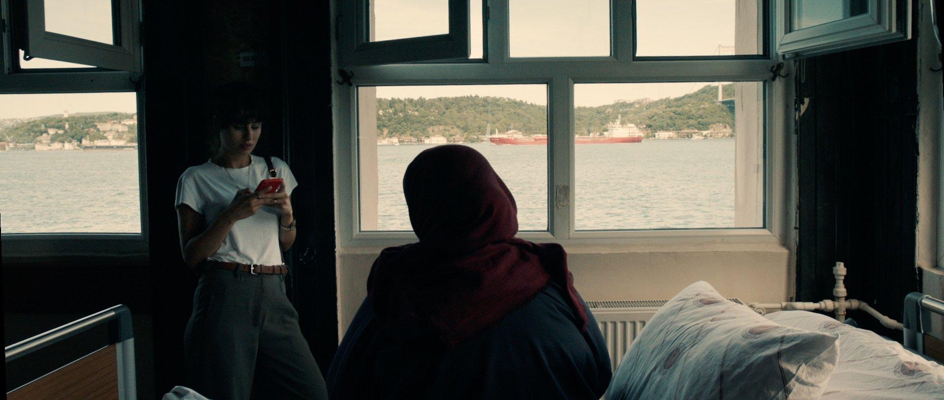 Selin Dumlugöl (L) and Şengül Deniz are seen in a scene from