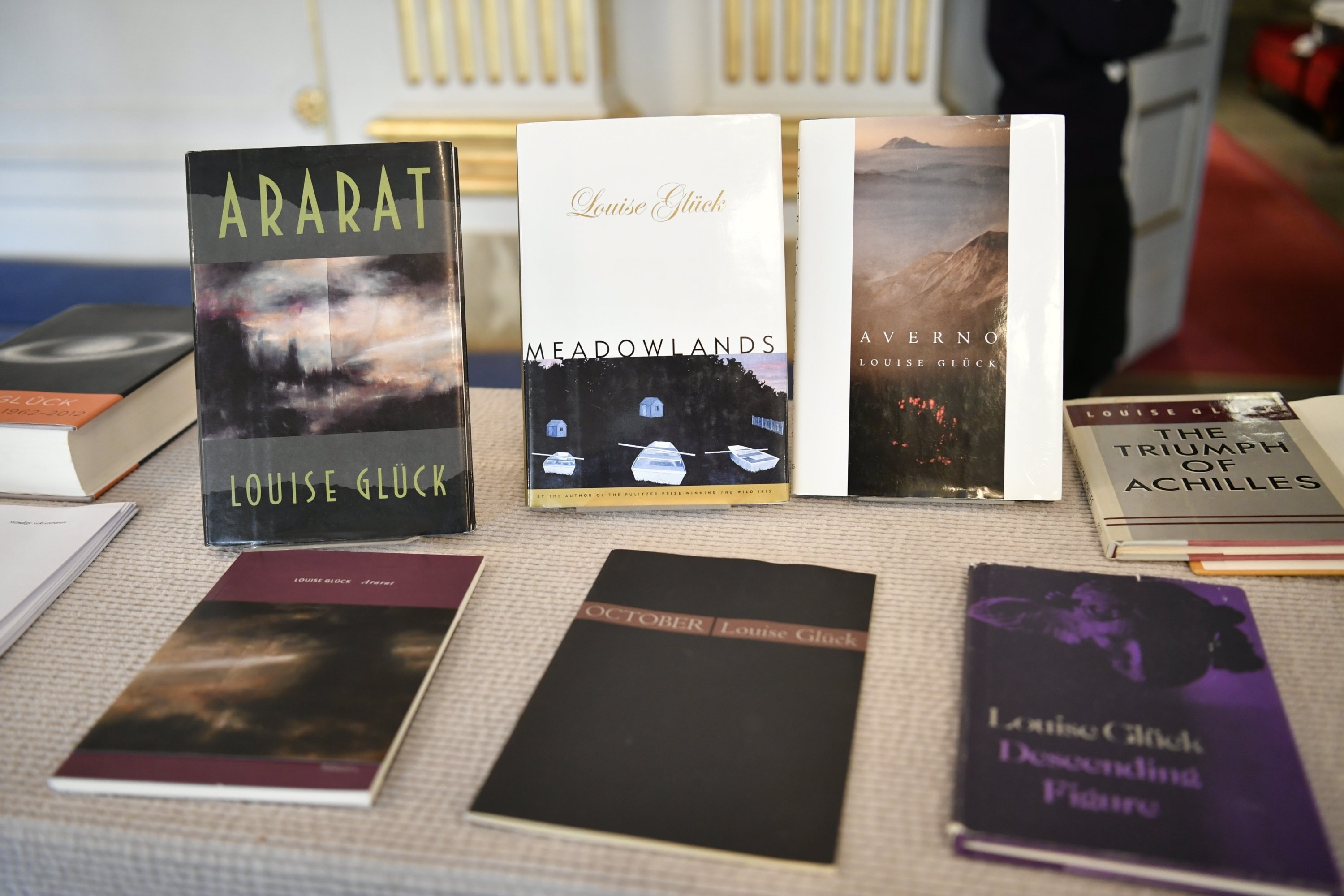 Books by Louise Gluck are displayed during the announcement of the 2020 Nobel Prize in Literature, in Stockholm, Oct. 8, 2020. (AP Photo)