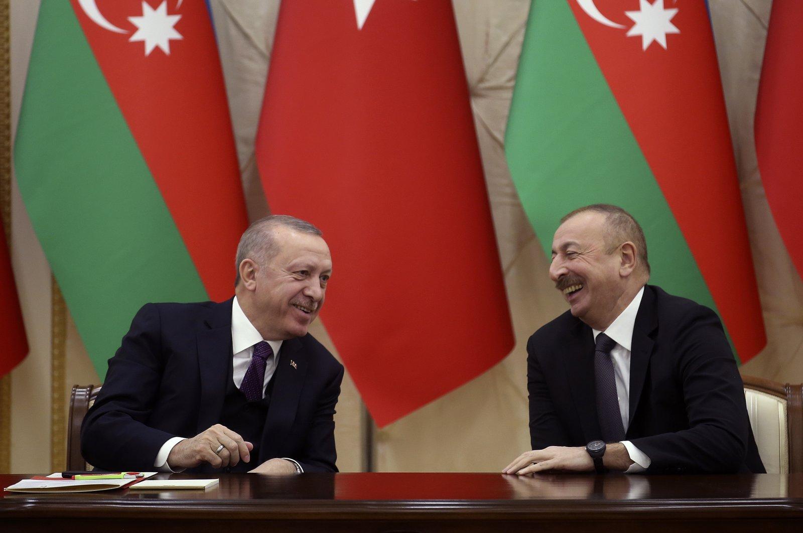 President Recep Tayyip Erdoğan (L) and Azerbaijani President Ilham Aliyev speak during a press conference, in Baku, Azerbaijan, Feb. 25, 2020. (AP Photo)