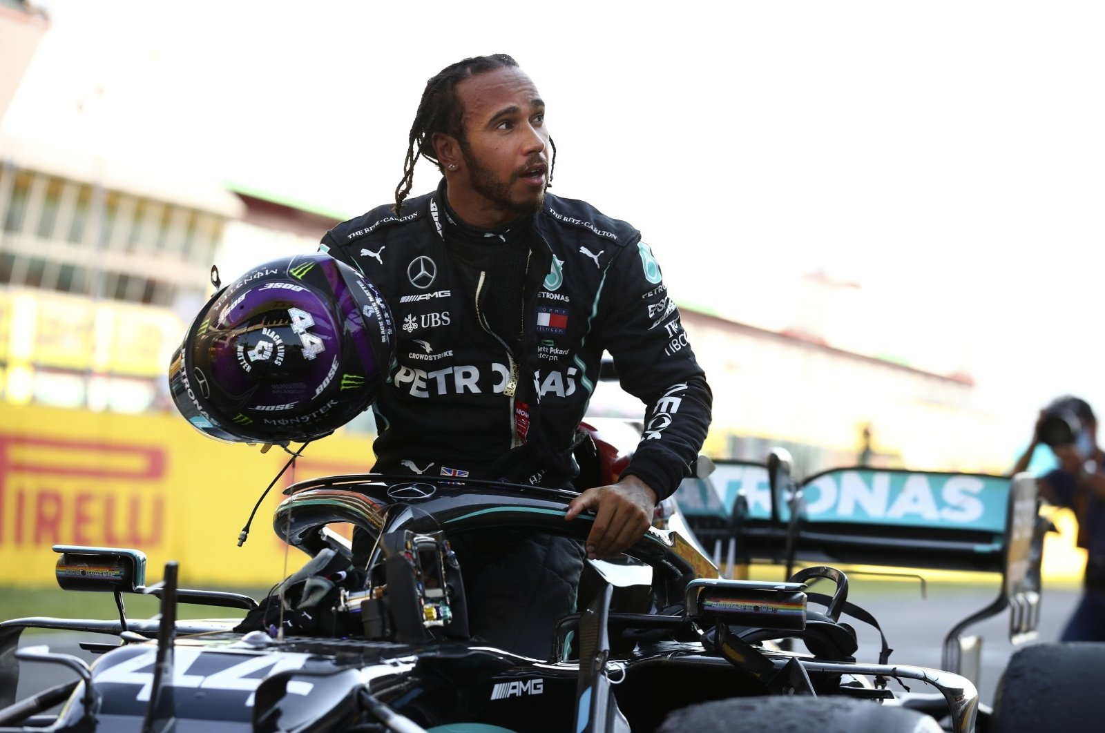 Lewis Hamilton steps out of his car after winning the Formula 1 Tuscany Grand Prix, in Scarperie, Italy, Sept. 13, 2020. (AP Photo)