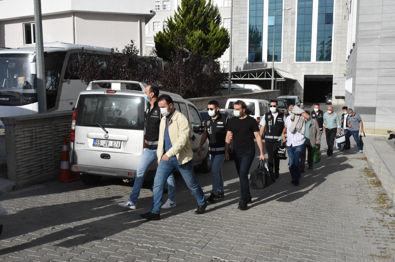 Police escort FETÖ suspects to the courthouse, in Samsun, northern Turkey, Oct. 8, 2020. (AA Photo)