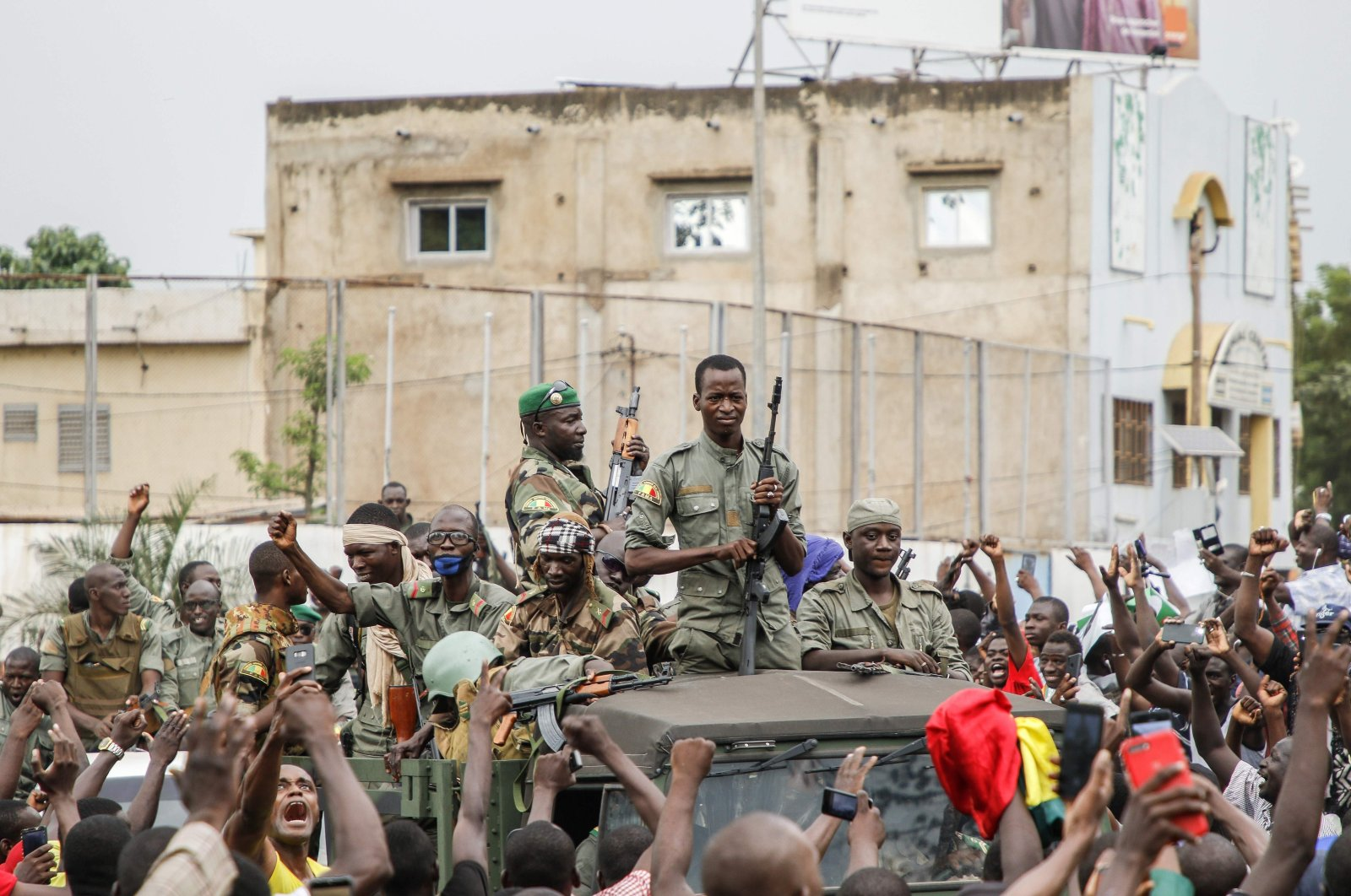 Armed members are celebrated by the population as they parade at Independence Square, Bamako, Mali, Aug. 18, 2020. (AFP Photo)