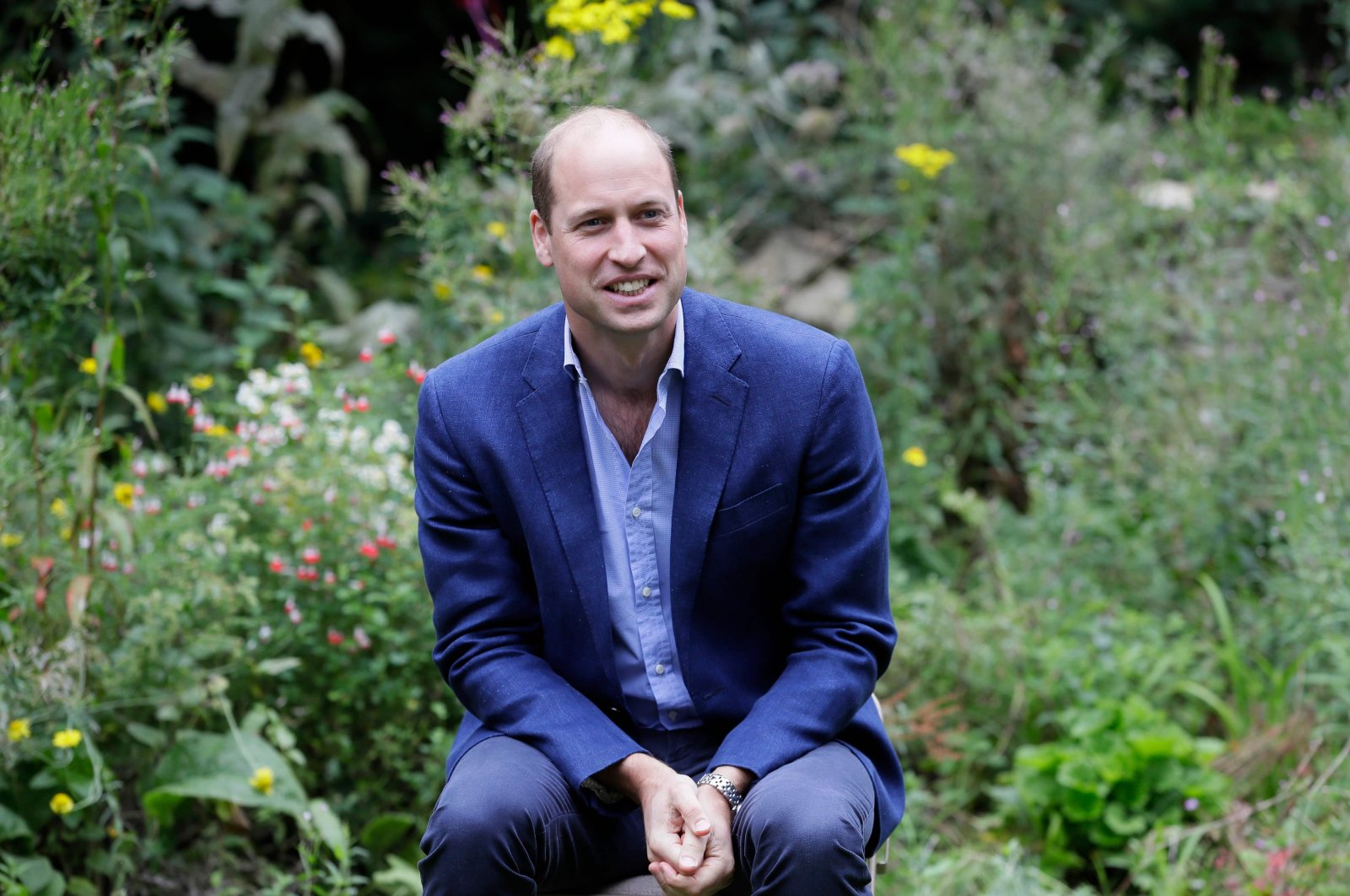 Prince William, Duke of Cambridge, speaks with visitors at the Garden House of the Light Project in Peterborough, England, June 16, 2020. (AFP Photo)