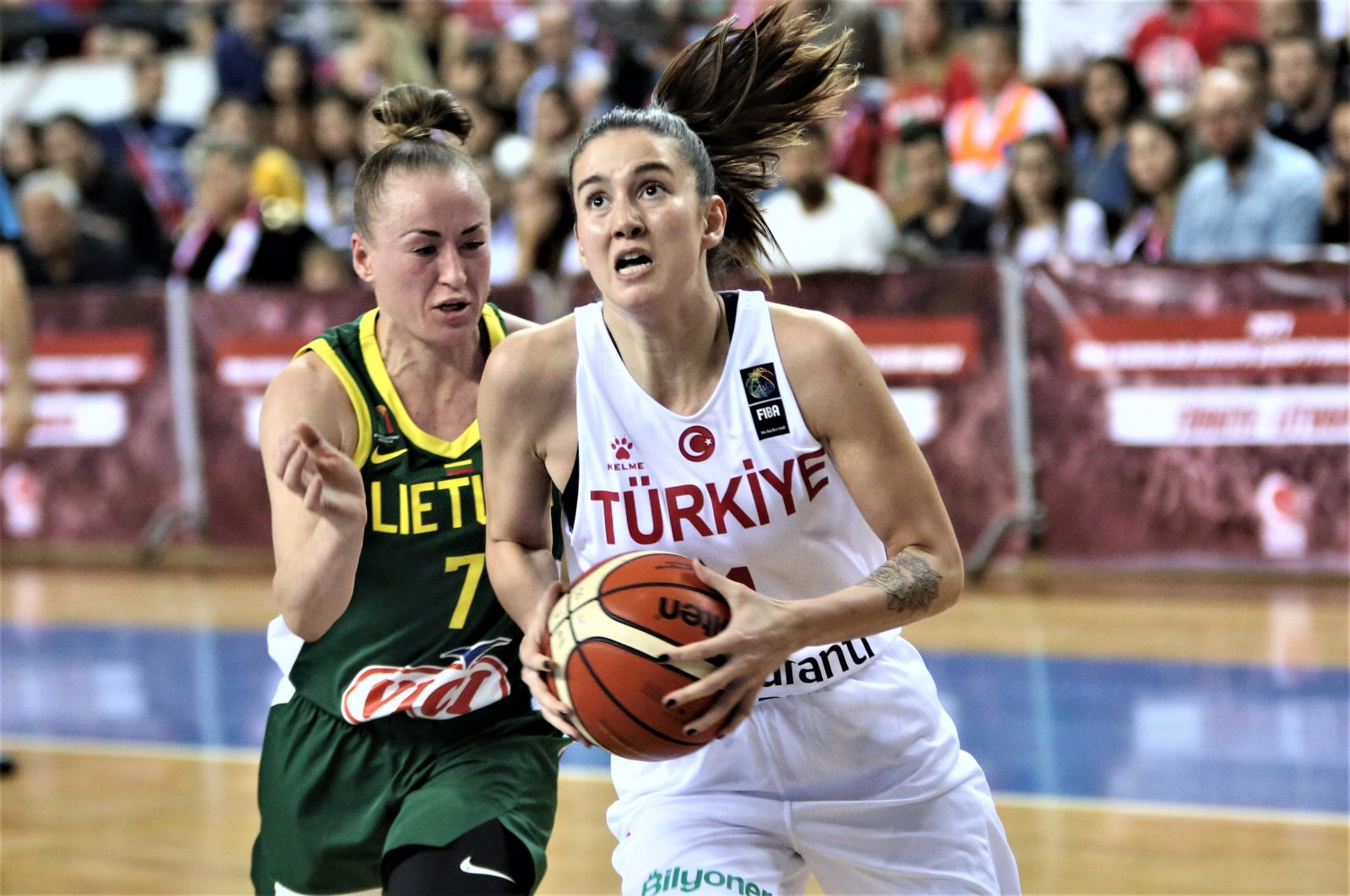 Olcay Çakır of Turkey (R) grabs the ball in a match against Lithuania in the 2021 qualifiers, in Mersin, southern Turkey, Nov. 17, 2019. (AA Photo)