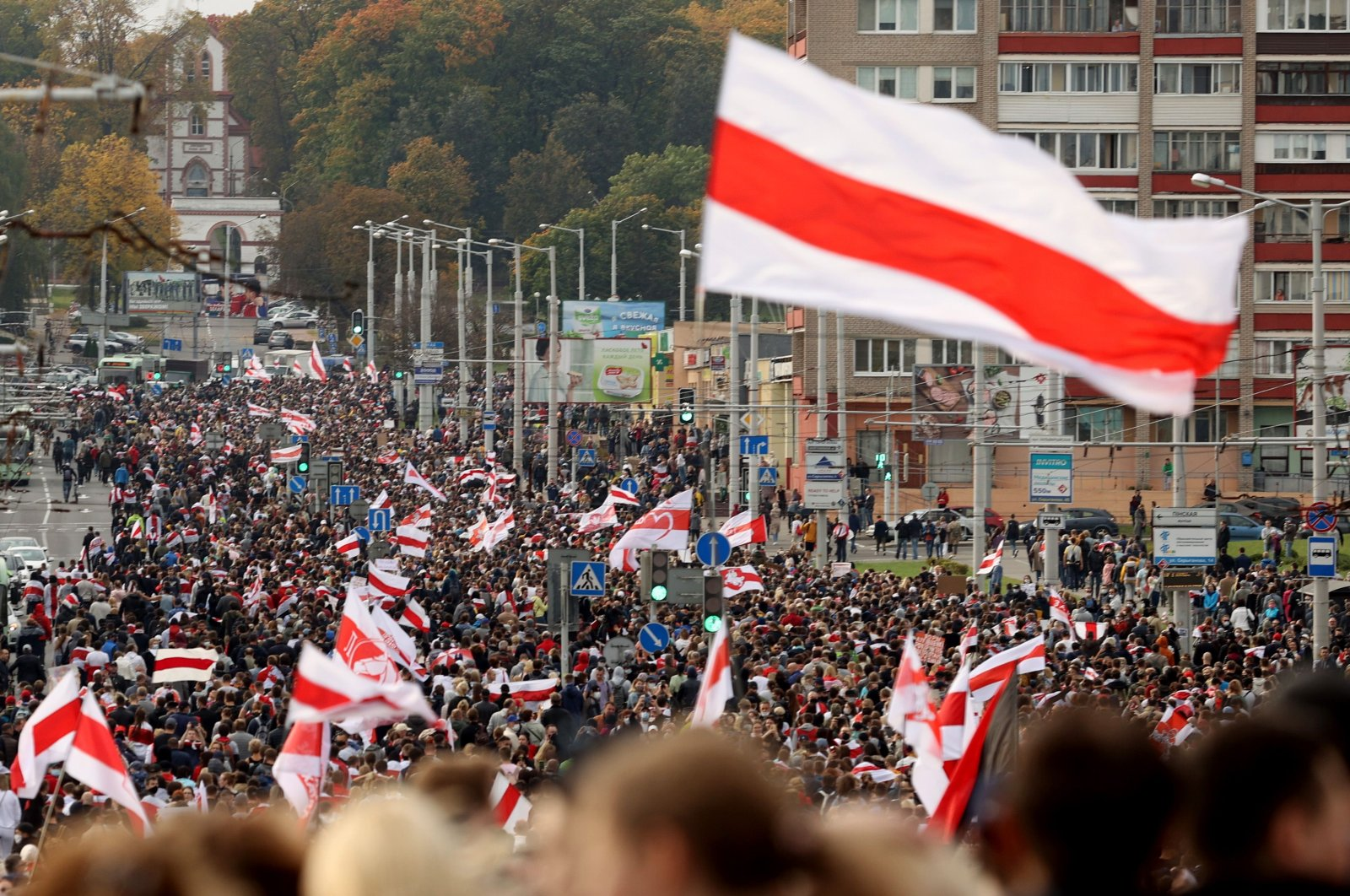 Protesters parade through the streets during a rally demanding the government free jailed activists of the opposition in Minsk, Belarus, on Oct. 4, 2020. (AFP Photo)