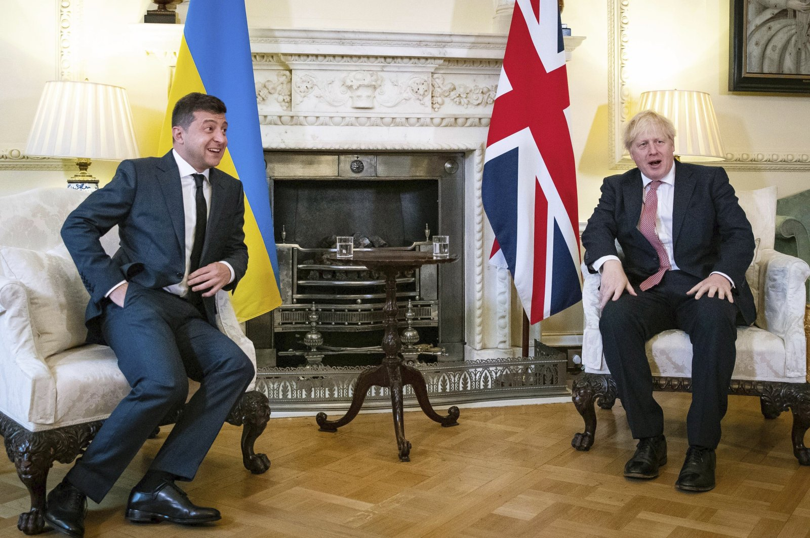 Britian's Prime Minister Boris Johnson (R) sits during a meeting with Ukraine President Volodymyr Zelenskyy in Downing Street, London, Oct. 8, 2020. (AP Photo)