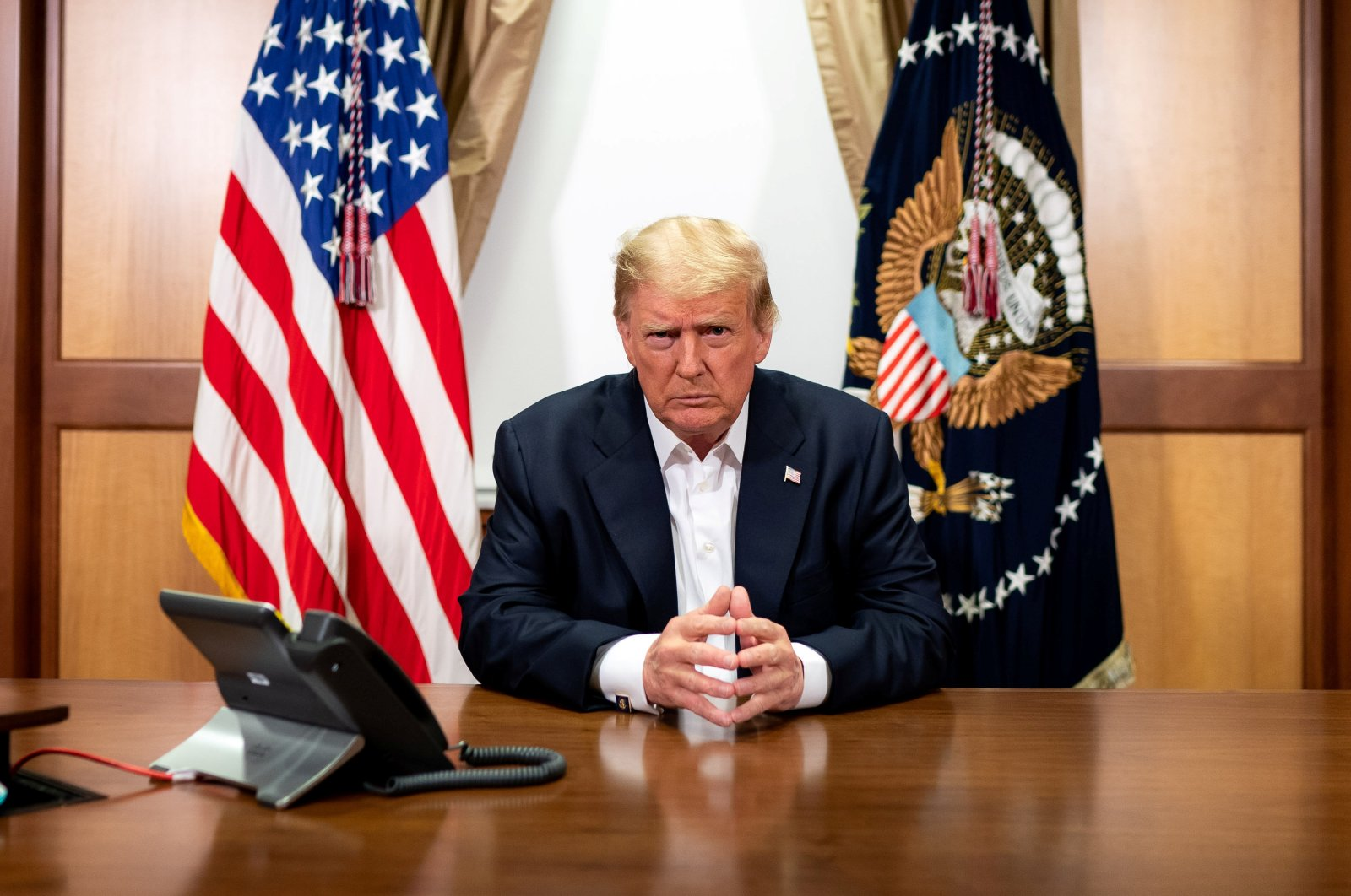 U.S. President Donald Trump participates in a phone call with Vice President Mike Pence, Secretary of State Mike Pompeo, and Chairman of the Joint Chiefs of Staff Gen. Mark Milley on Oct. 4, 2020. (Reuters Photo)