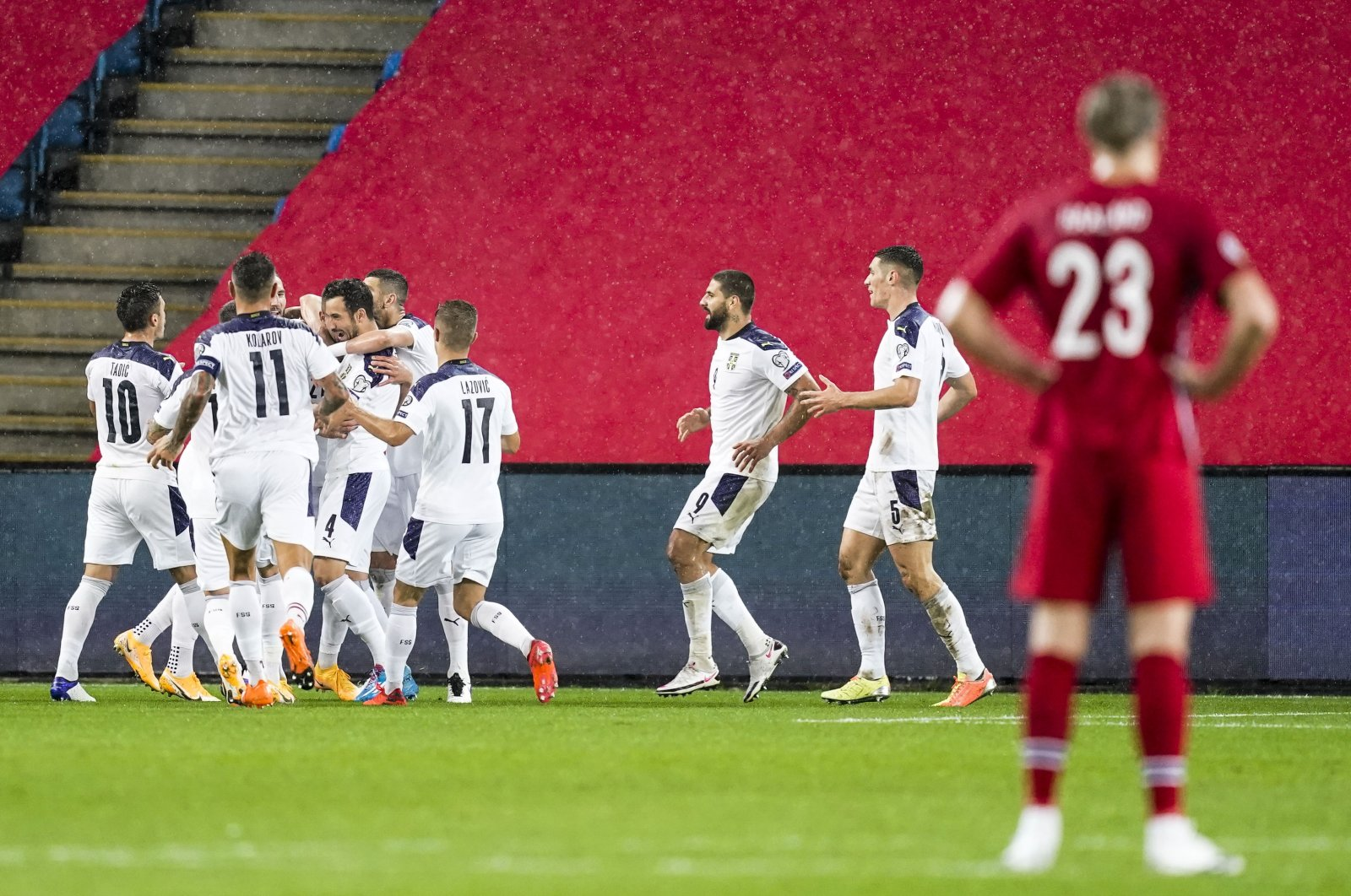 Norway's Erling Braut Haaland looks on as Serbia's players celebrate a goal during a Euro 2020 qualifying match, in Oslo, Norway, Oct. 8, 2020. (AFP Photo)