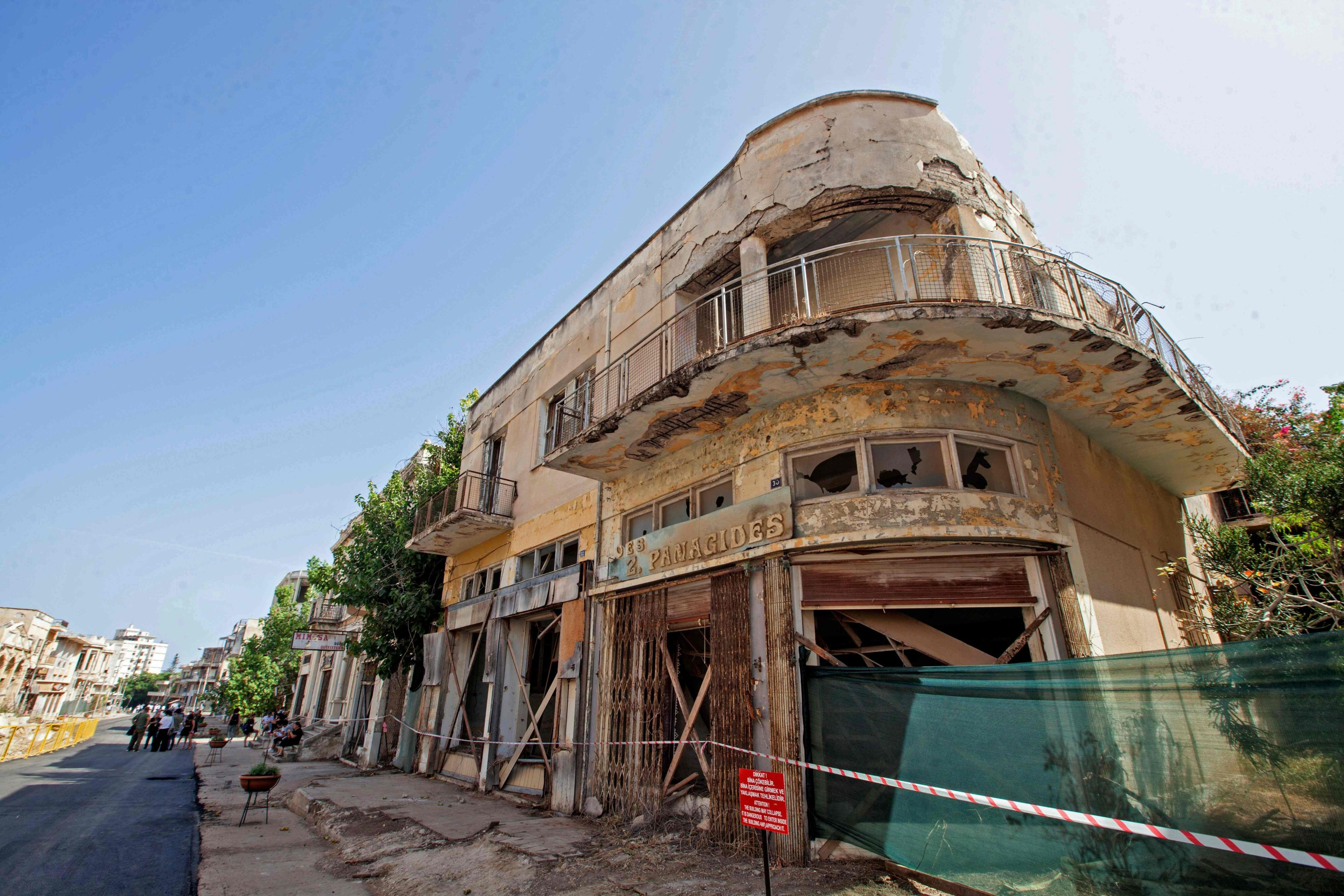 A view of abandoned buildings along a street in Varosha (Maraş) on the divided island of Cyprus, Oct. 8, 2020. (AFP Photo)