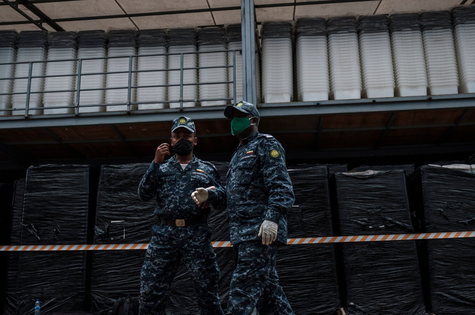 Police officers guard ballot boxes in a warehouse of the National Election Board of Ethiopia (NEBE), in Addis Ababa, Ethiopia, Oct. 2, 2020. (AFP Photo)