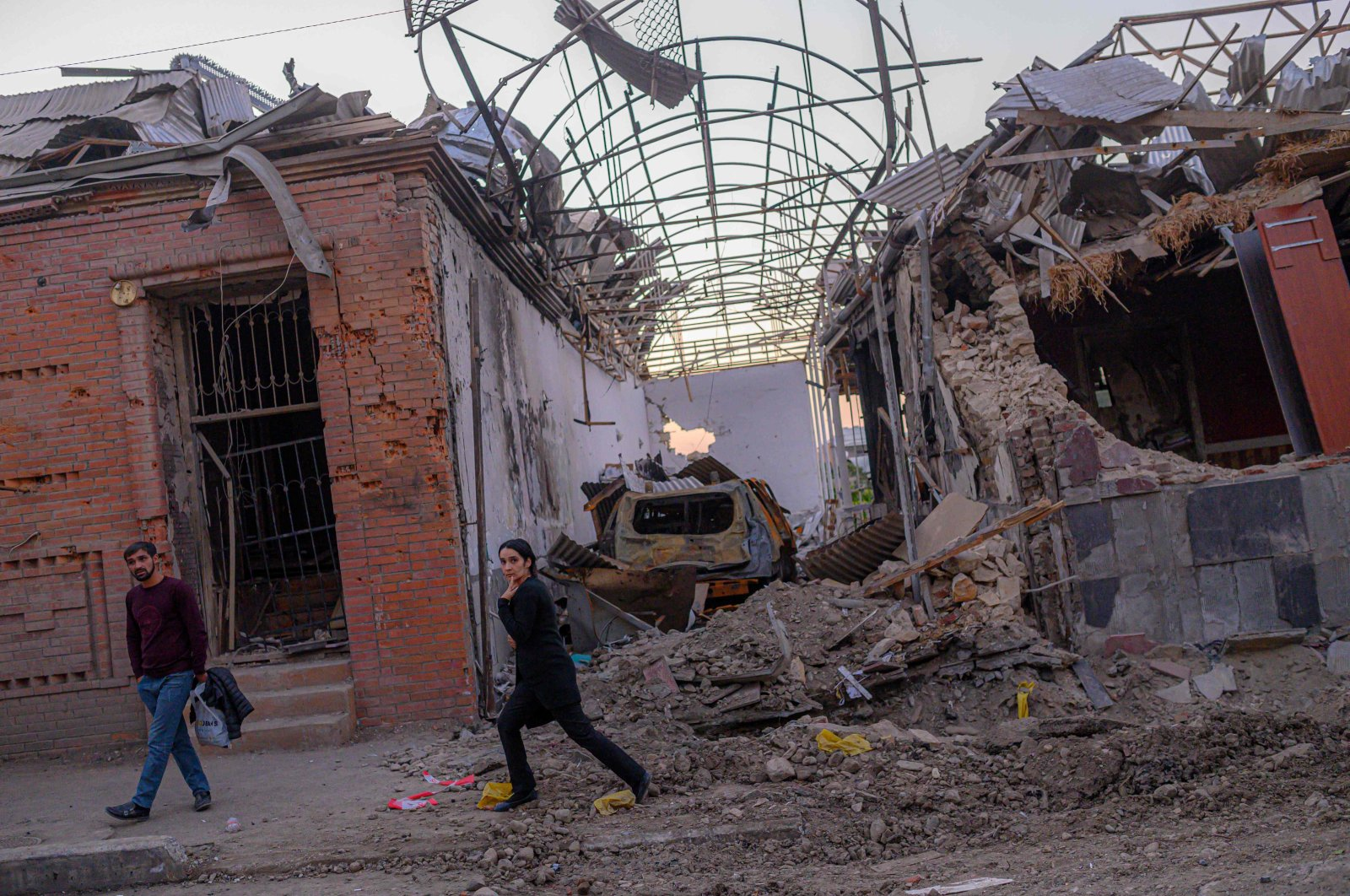 Local residents walk in a street after it was hit by an Armenian missile in Ganja, Azerbaijan, Oct. 8, 2020. (AFP Photo)