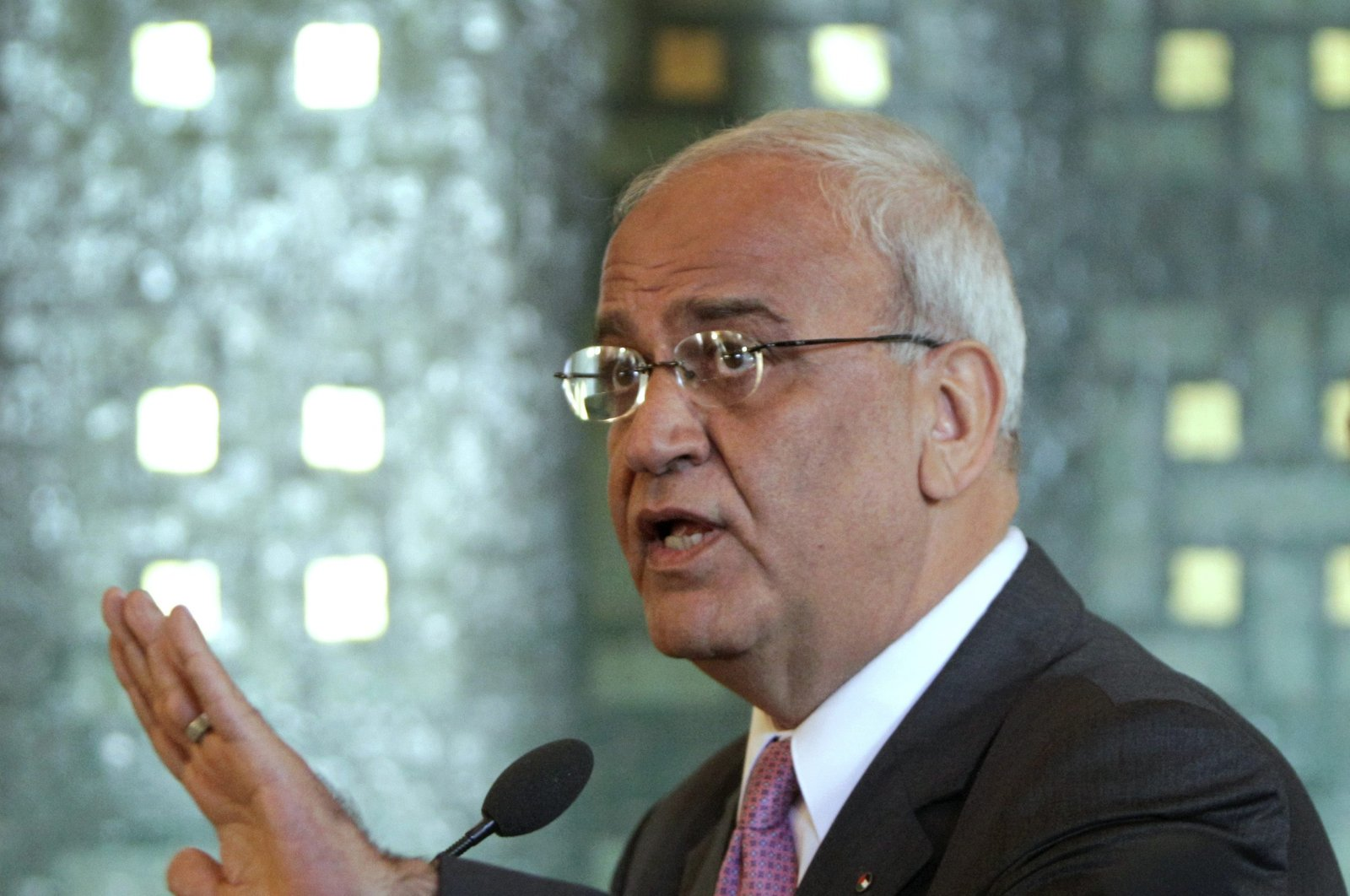 Chief Palestinian negotiator Saeb Erekat talks during a press conference with Arab League Secretary-General Nabil al-Arabi, not pictured, at the Arab League headquarters in Cairo, Egypt, Oct. 2, 2011. (AP Photo)