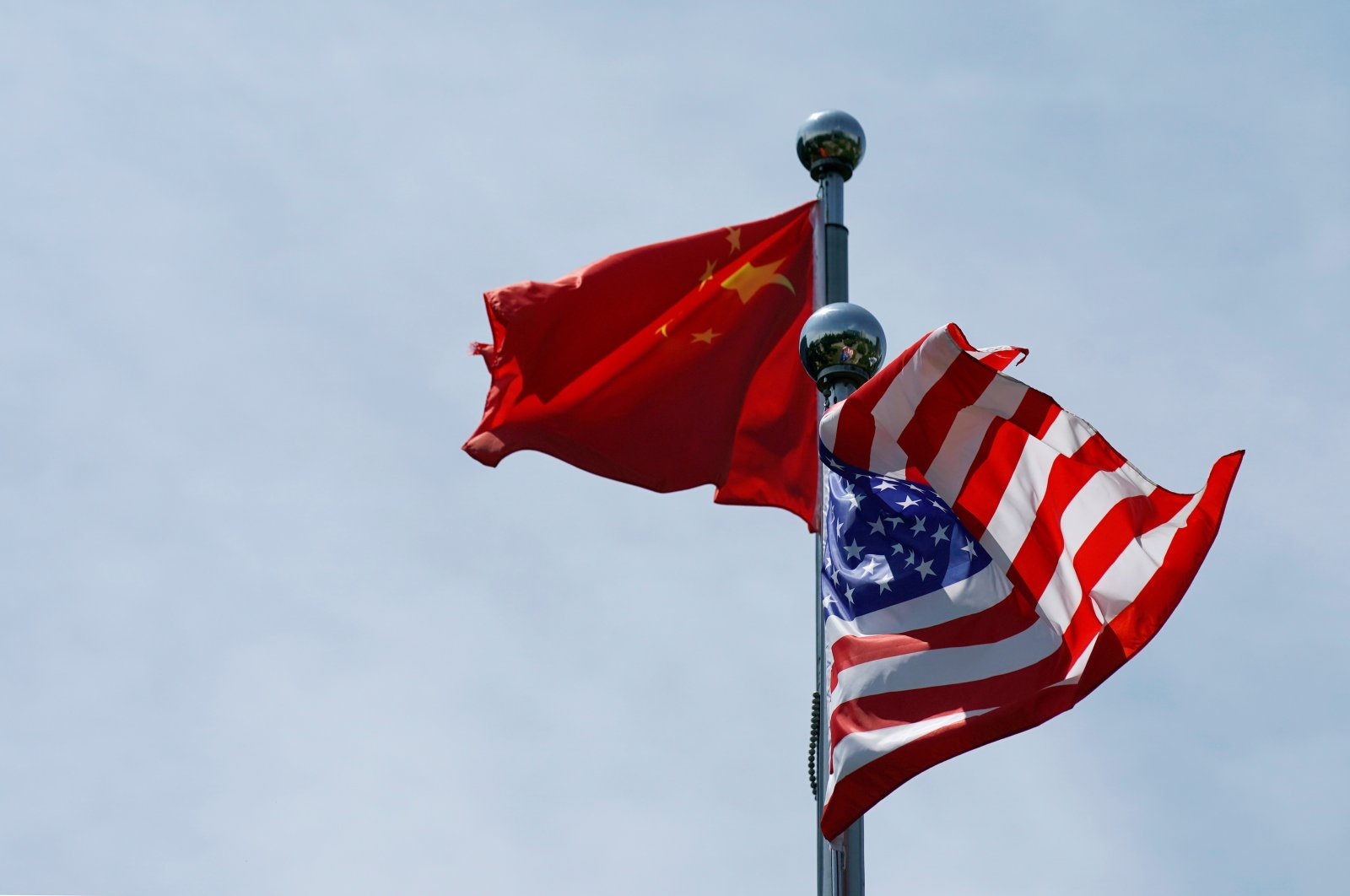 The Chinese and U.S. flags flutter near the Bund waterfront area in Shanghai, China, July 30, 2019. (Reuters Photo)