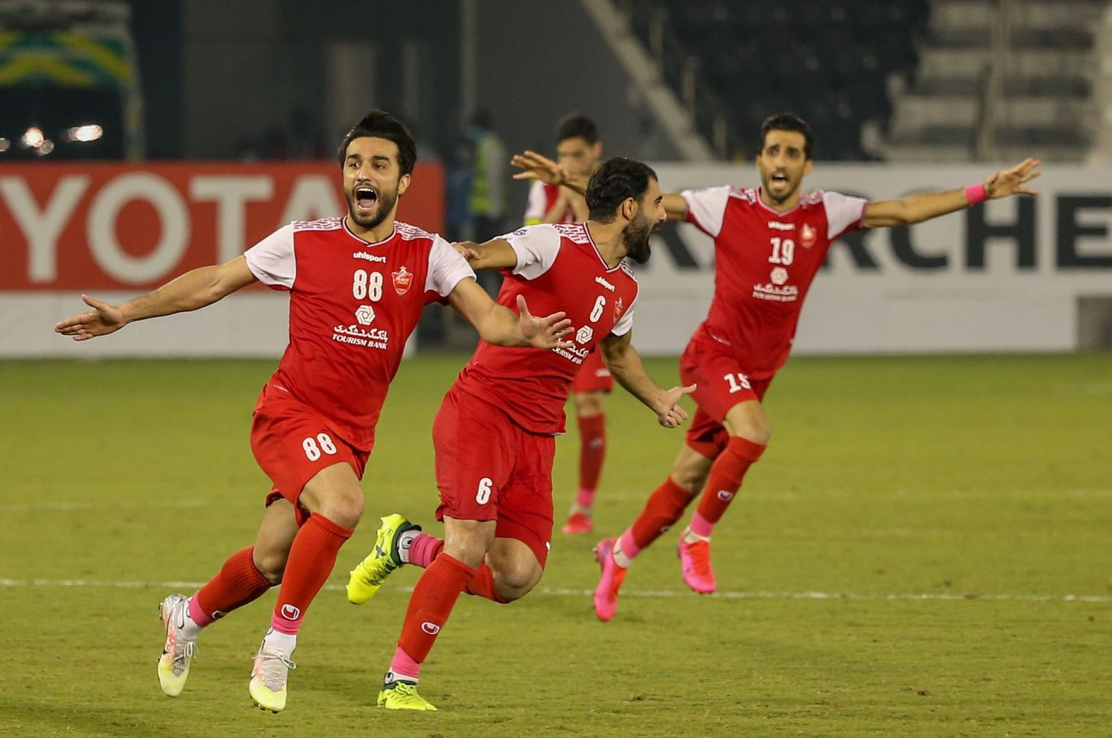 Persepolis players celebrate winning an AFC Champions League match against Al-Nassr, in Doha, Qatar, Oct. 3, 2020. (AFP Photo)