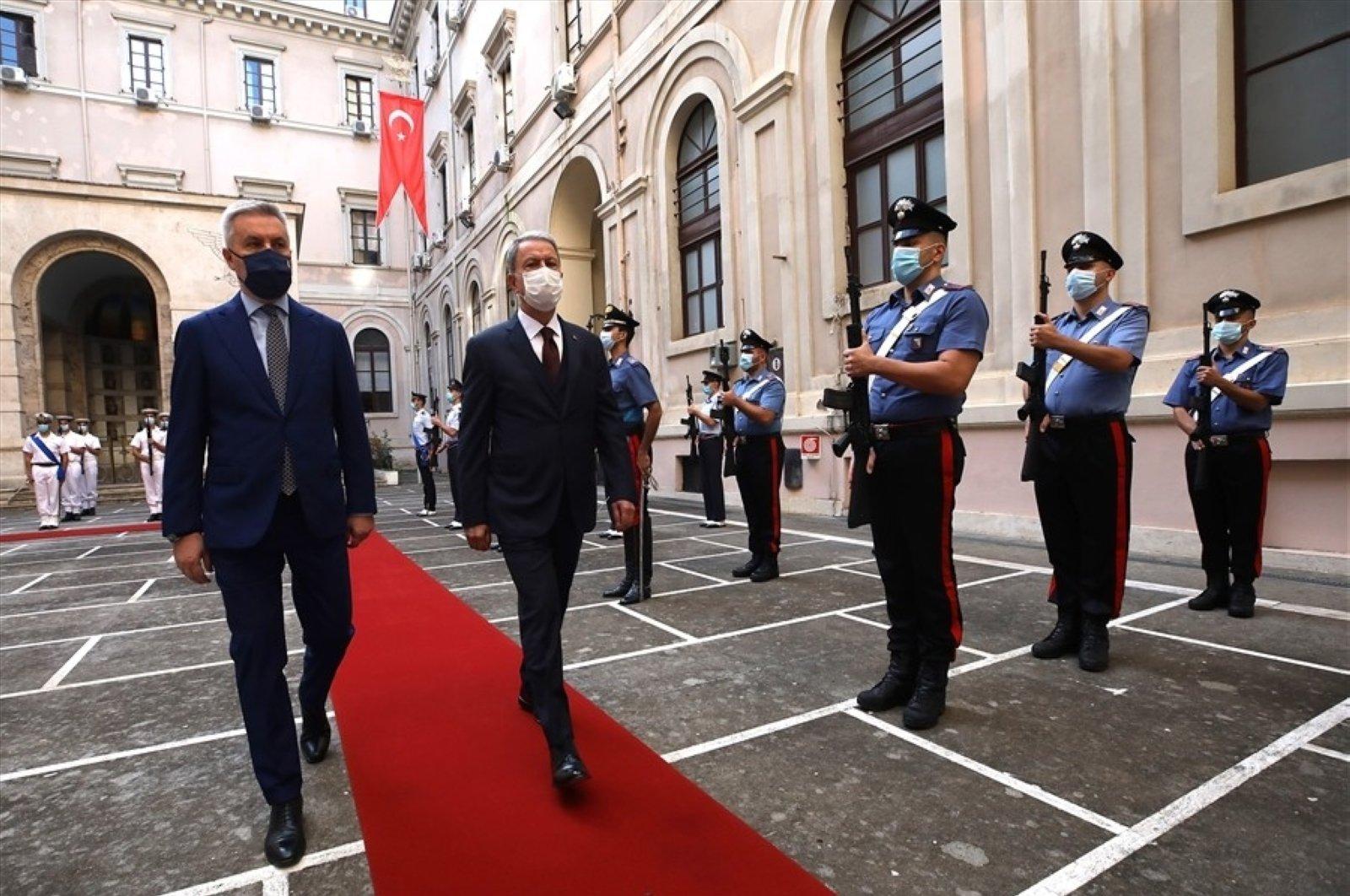 Turkish Defense Minister Hulusi Akar (R) walks beside his Italian counterpart Lorenzo Guerini during a military ceremony at the Italian Defense Ministry, Rome, Italy, Oct. 9, 2020. (IHA Photo)