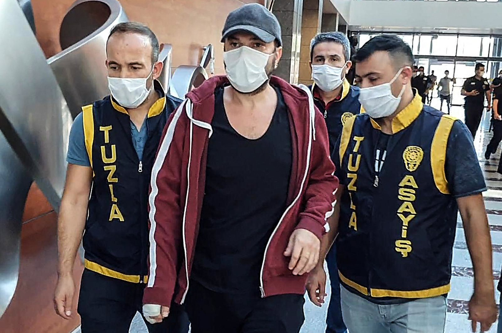 Police escort Halil Sezai Paracıkoğlu (C) to the courthouse in Istanbul, Turkey, Sept. 17, 2020. (AA Photo)