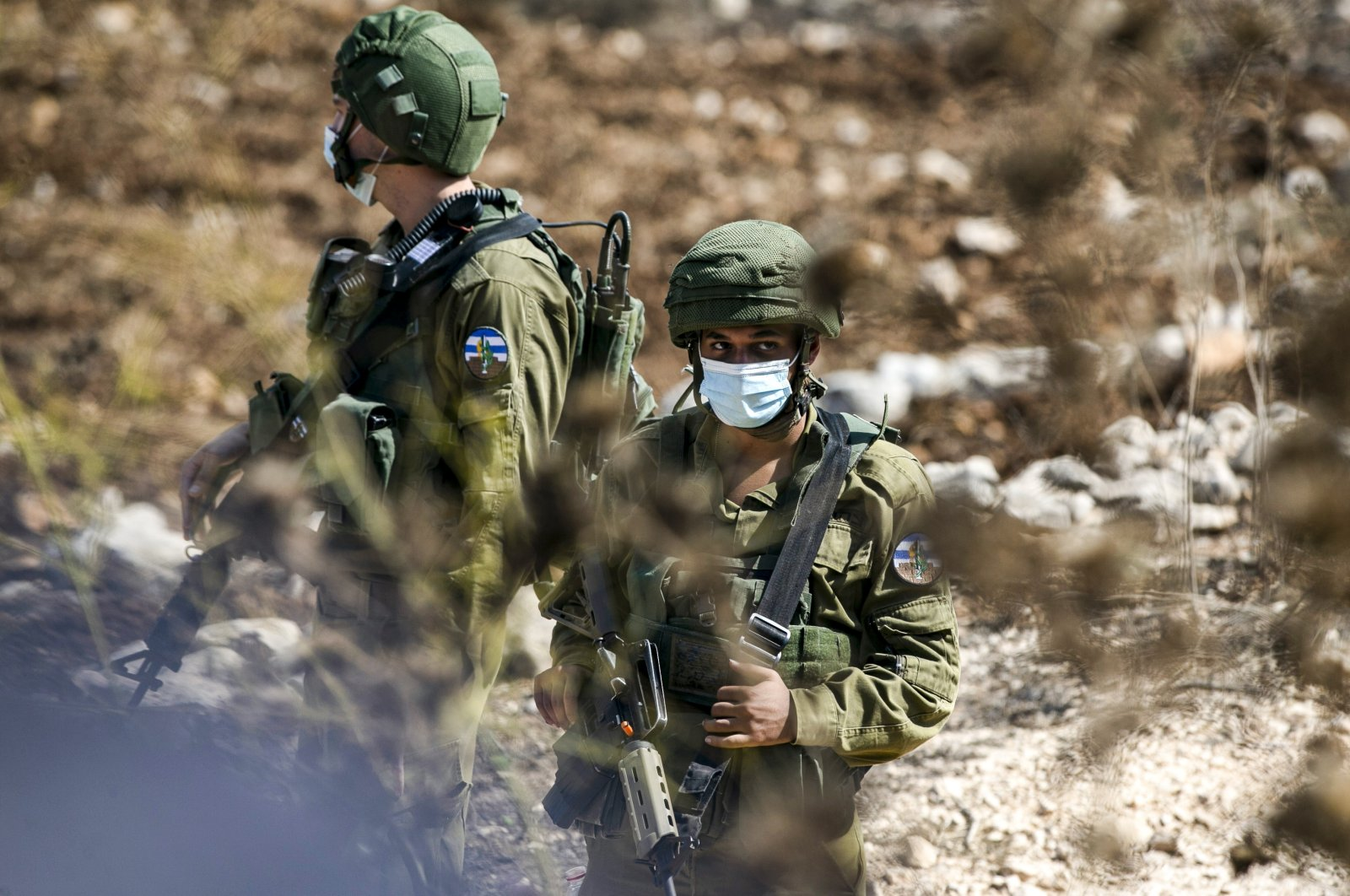 Israeli soldiers, mask-clad due to the coronavirus pandemic, stand by in the town of Asira Shamaliya in the occupied West Bank near Nablus, Palestine, Oct. 9, 2020. (AFP Photo)