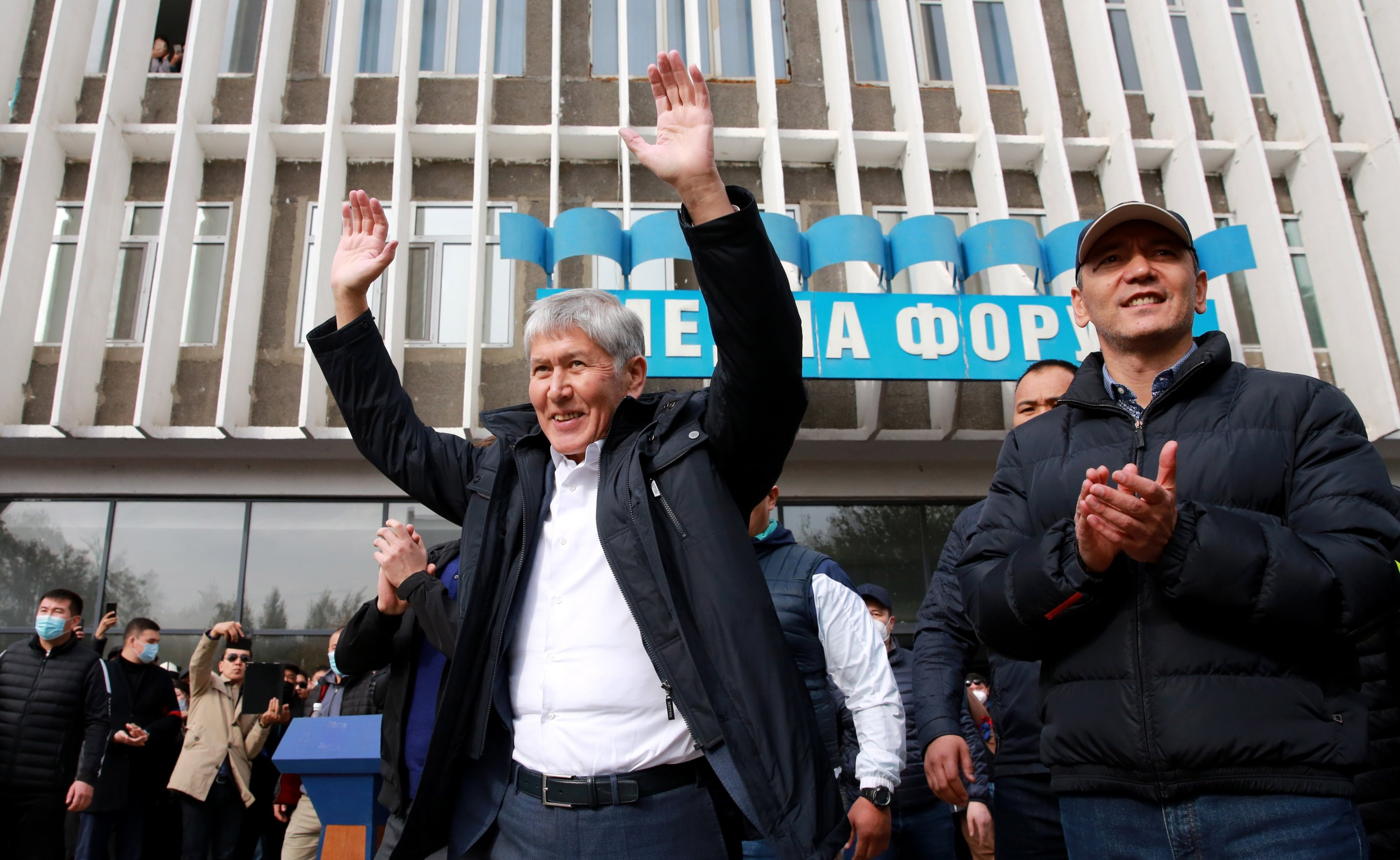 Kyrgyzstan's former President Almazbek Atambayev (C) during a rally of his supporters outside the offices of Media Forum in Bishkek, Kyrgyzstan Oct. 09, 2020. (EPA Photo)